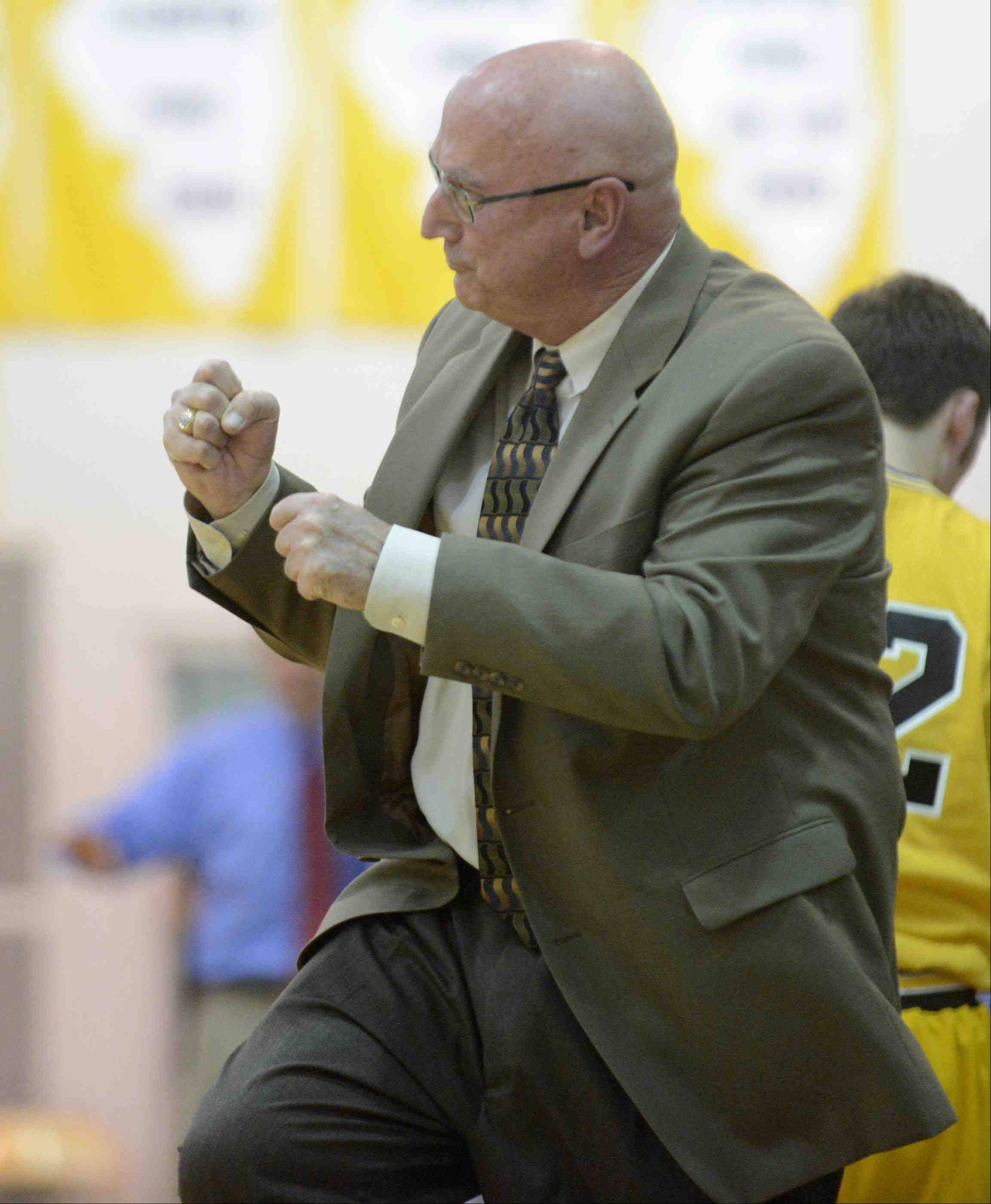 Jacobs head coach Jim Hinkle reacts near the end of his team's 50-45 win over Dundee-Crown in the Class 4A Jacobs Class 4A regional semifinal Wednesday. The win puts the Golden Eagles and the retiring Hinkle into Friday's championship game against Crystal Lake Central.