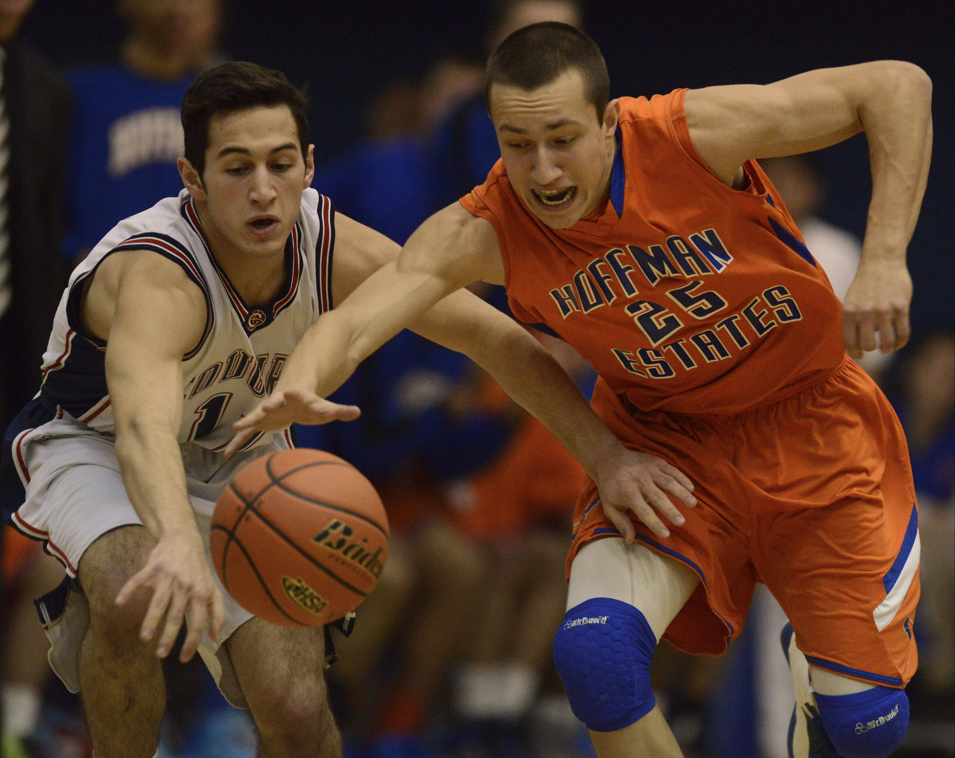 Conant's Joey Ranallo, left, attempts to steal the ball from Hoffman Estates' Jimmy Ward during Wednesday's Class 4A regional quarterfinal at Hoffman Estates.