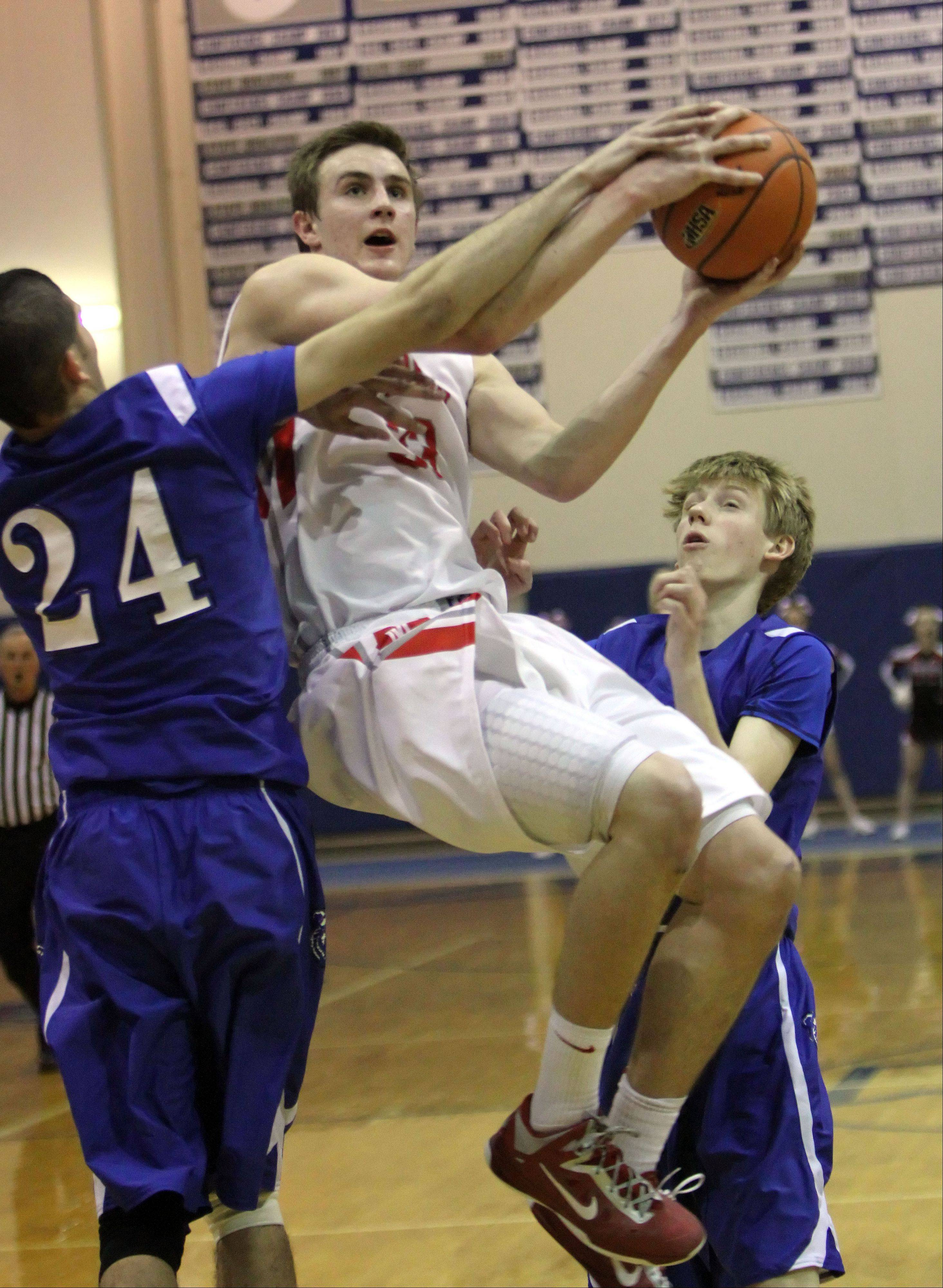 Mundelein's Sean O'Brien, left, drives on Lake Zurich's Shahzaad Khan.