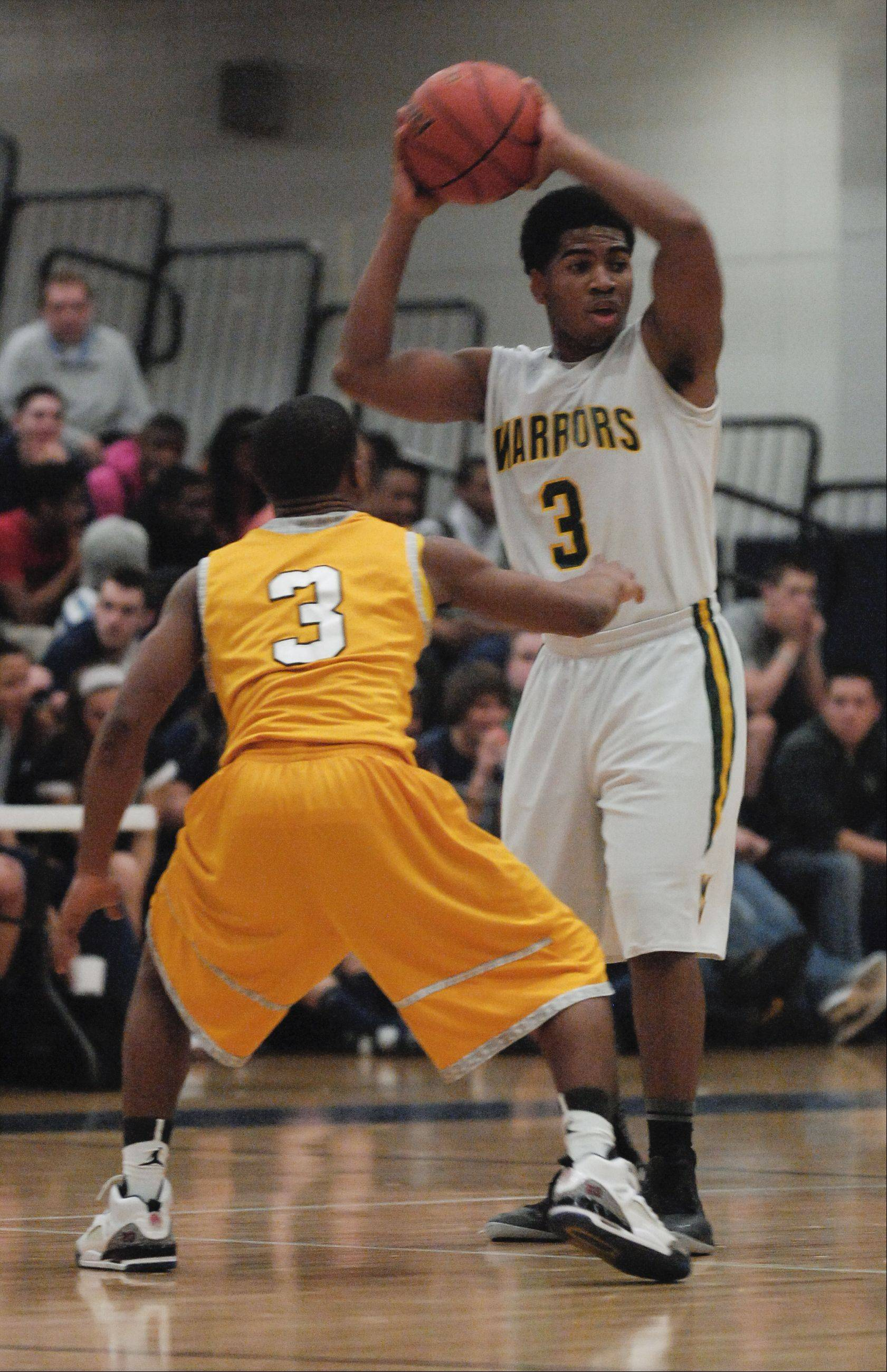 Gary Sutton of Waubonsie Valley looks to pass around Bryson Oliver of Metea Valley.