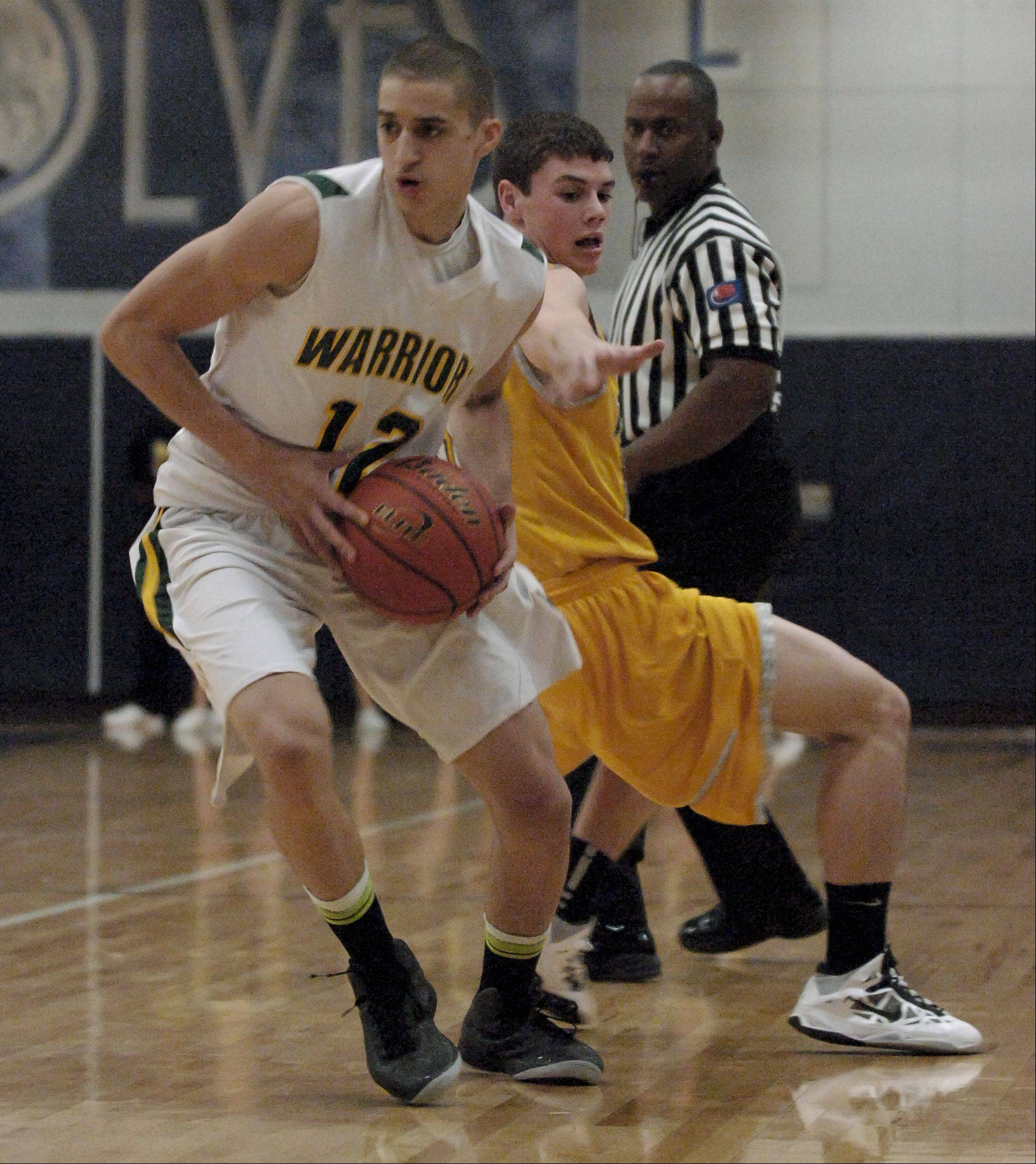 Waubonsie Valley played Metea Valley Wednesday night for Class 4A boys basketball regional semifinals at Oswego East.