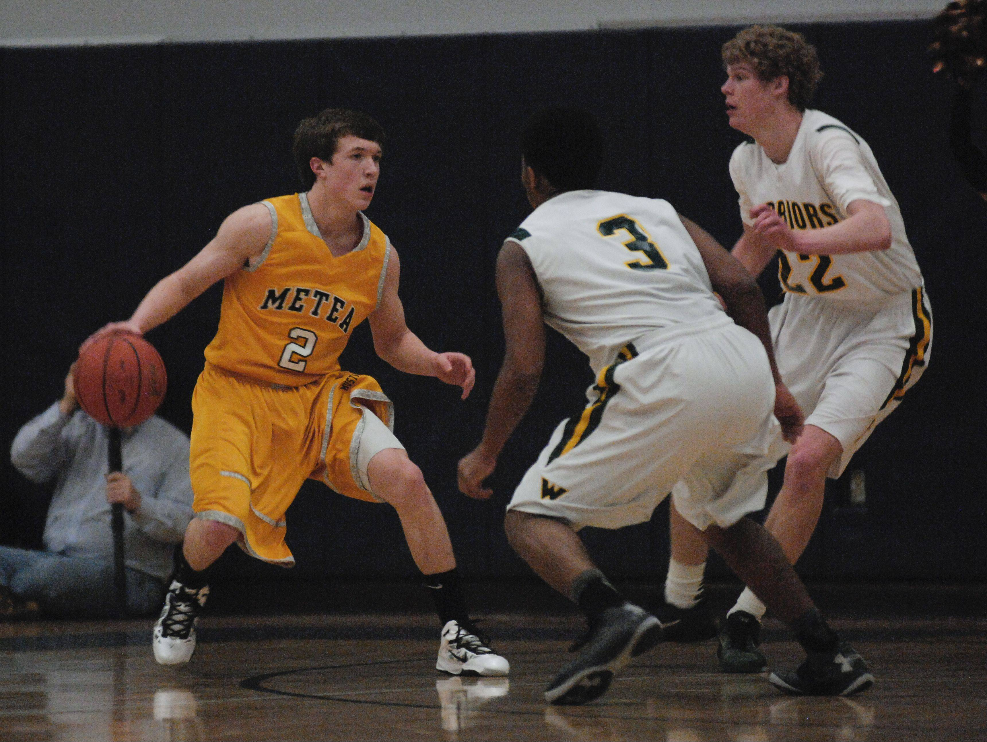 Connor Archey of Metea Valley looks to move around Waubonsie Valley defenders.