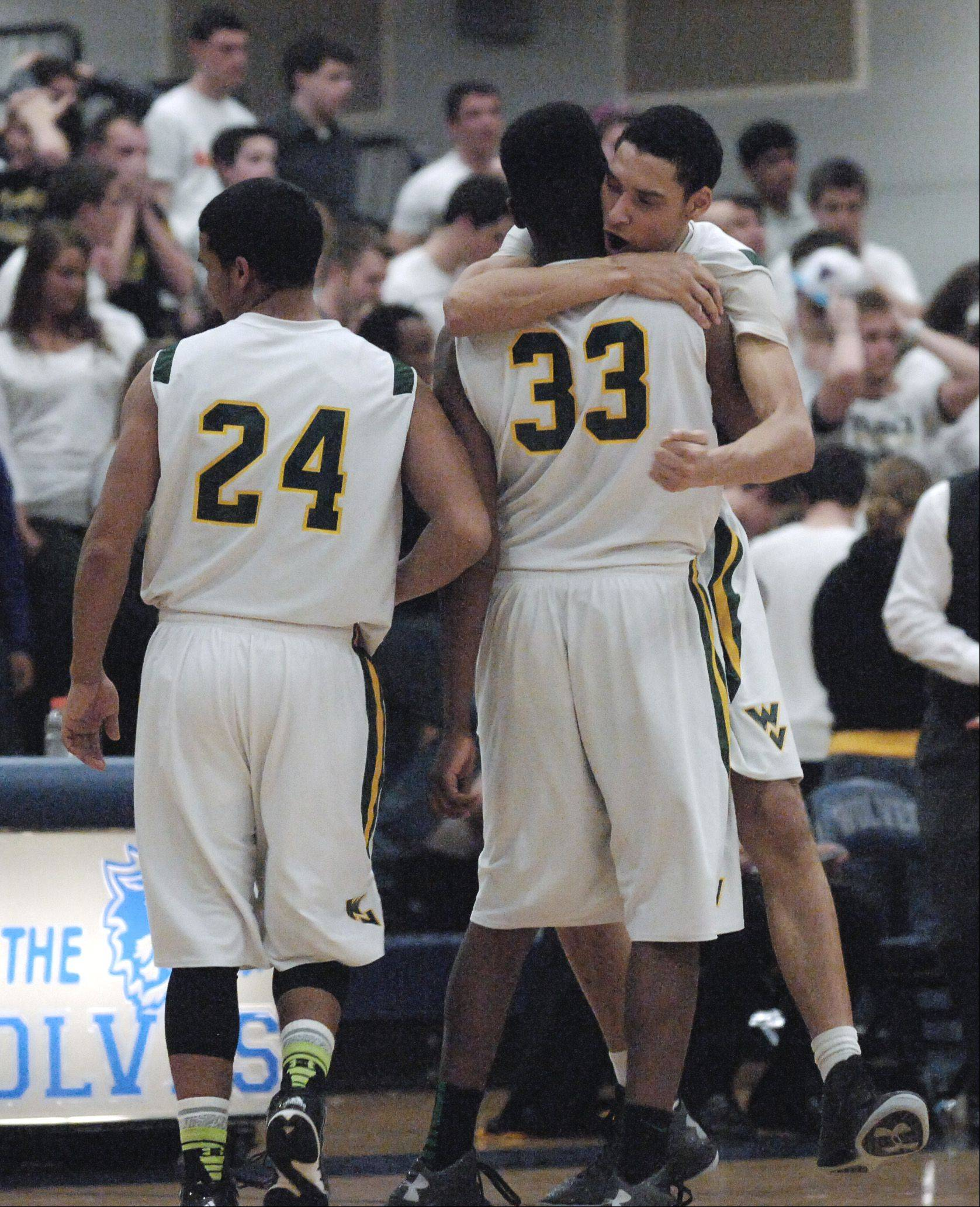 Waubonsie Valley players celebrate defeating Metea Valley 51-48 in overtime.