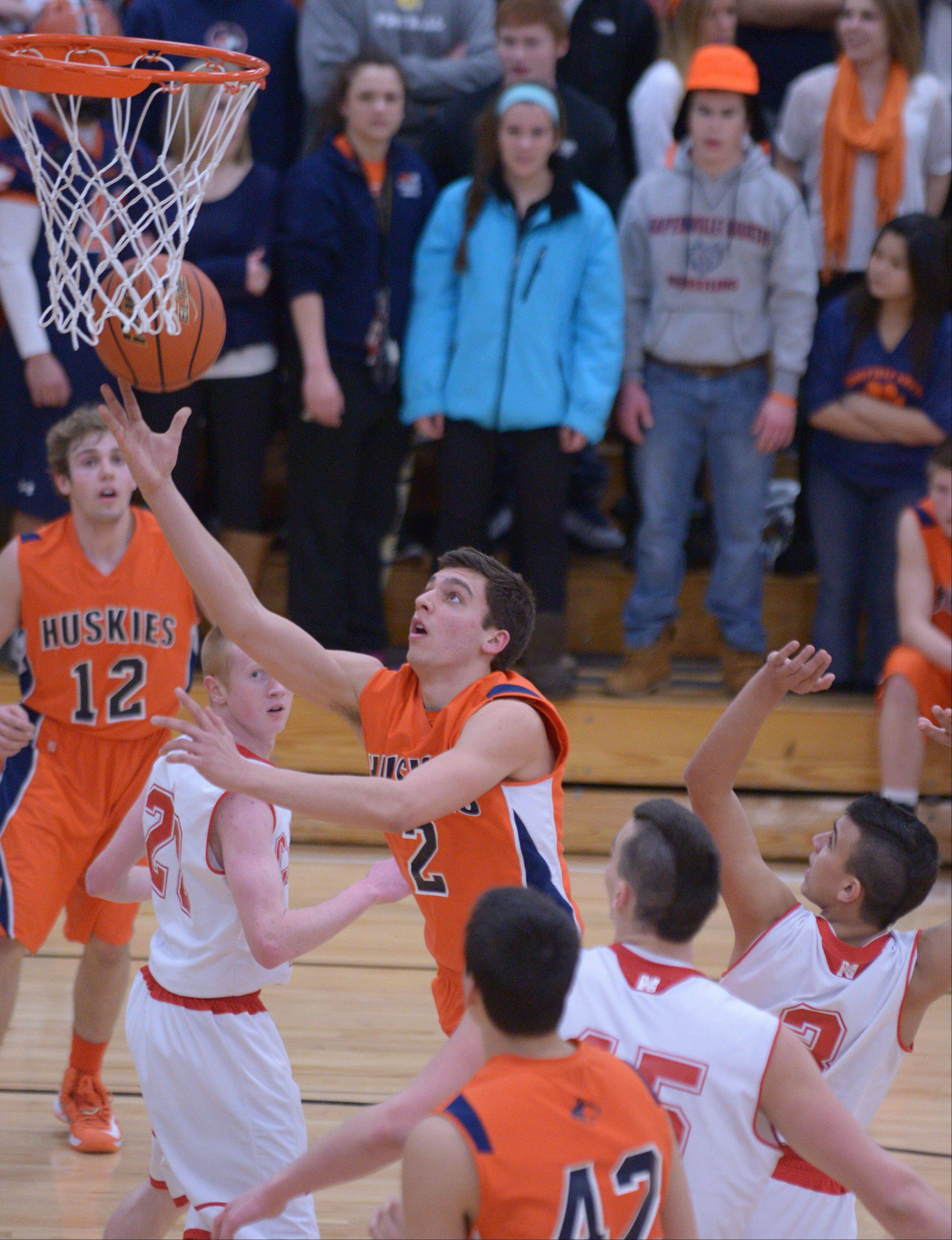 Anthony Rehayem of Naperville North takes one to the net during the Naperville North vs. Naperville Central at Class 4A Benet boys basketball regional semifinals game Thursday.