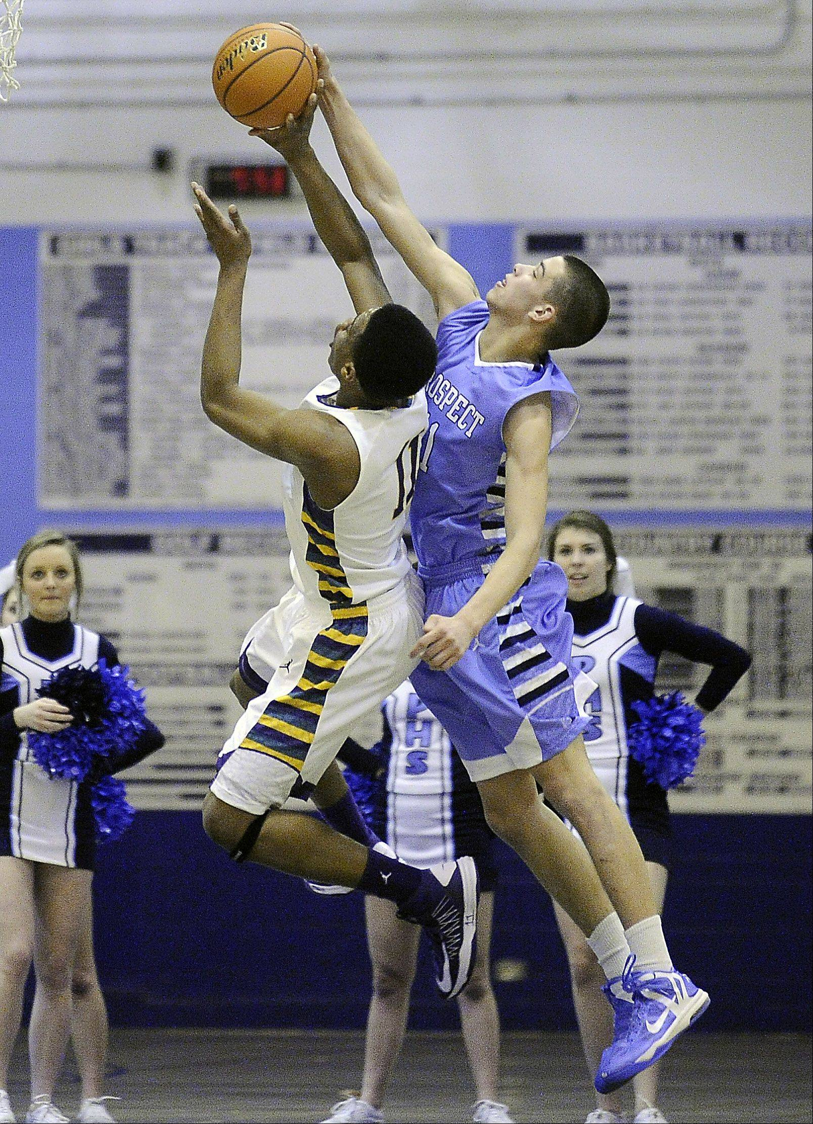 Prospect's Devin O'Hara swipes the ball away from Waukegan's Jerome Davis under the basket in the first half.