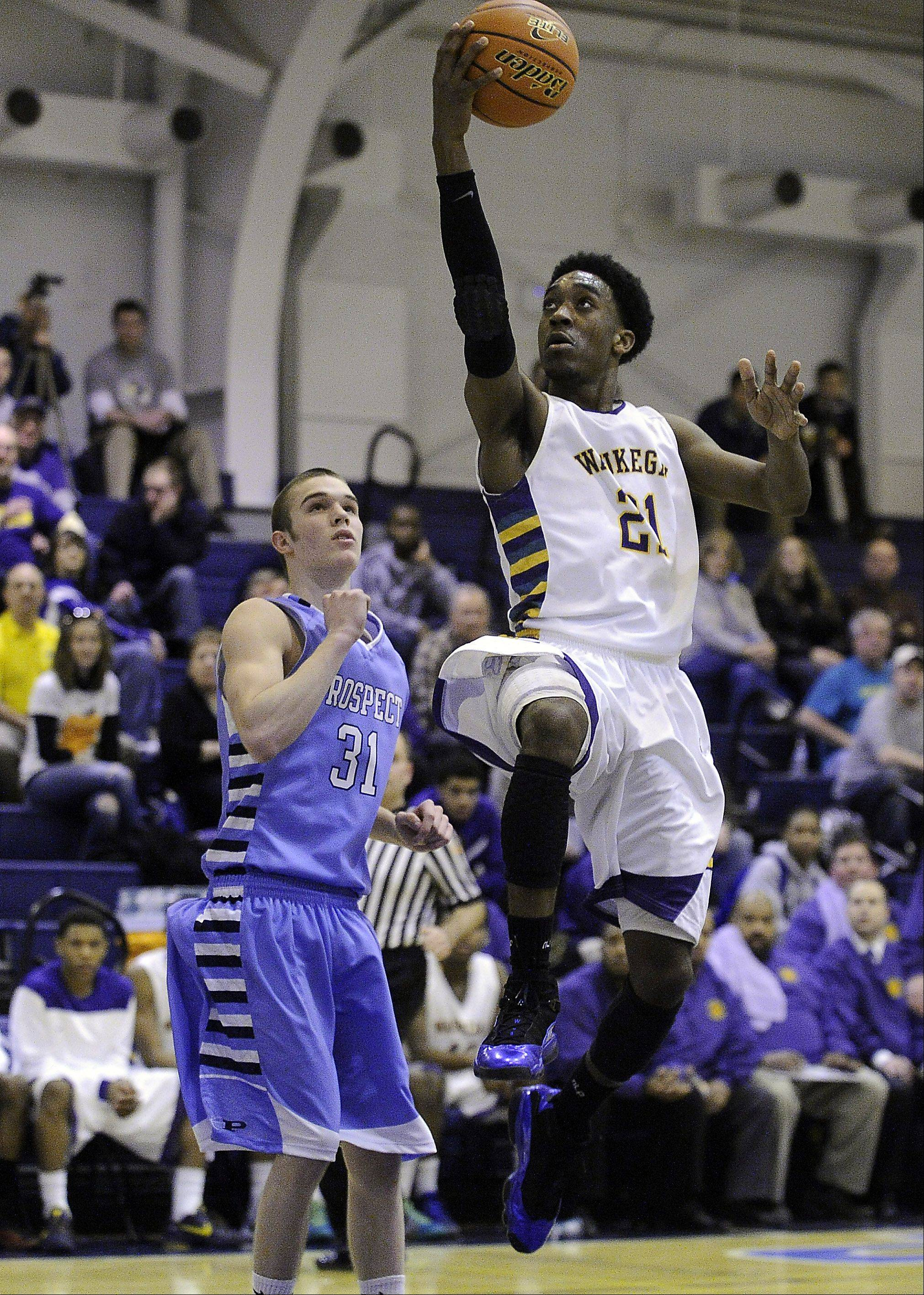 Prospect's Jake Young and the rest of the defense try to stop Waukegan's Devonte Taylor in the second half.