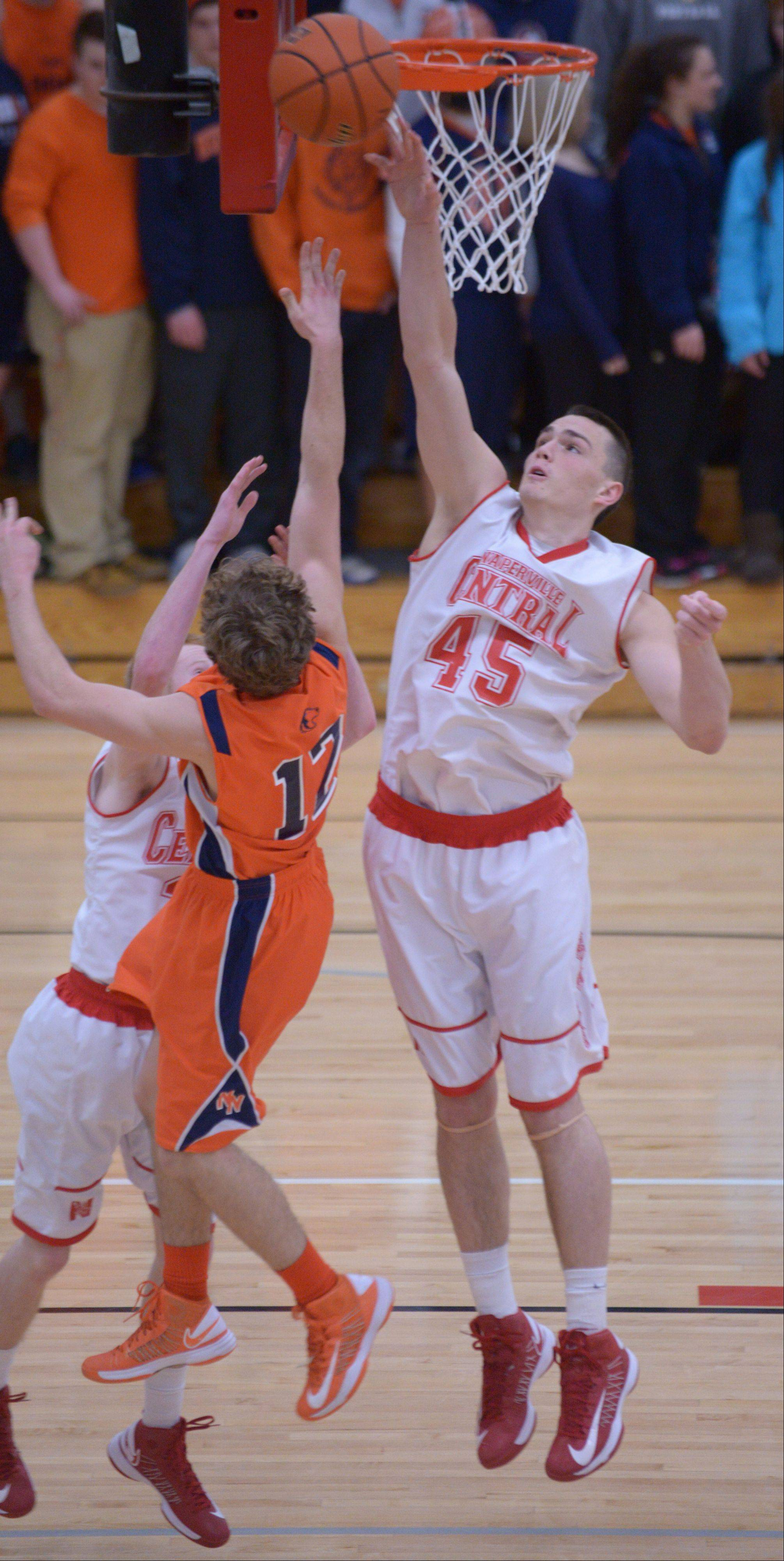 Nick Czarnowski of Naperville Central goes up for a block .