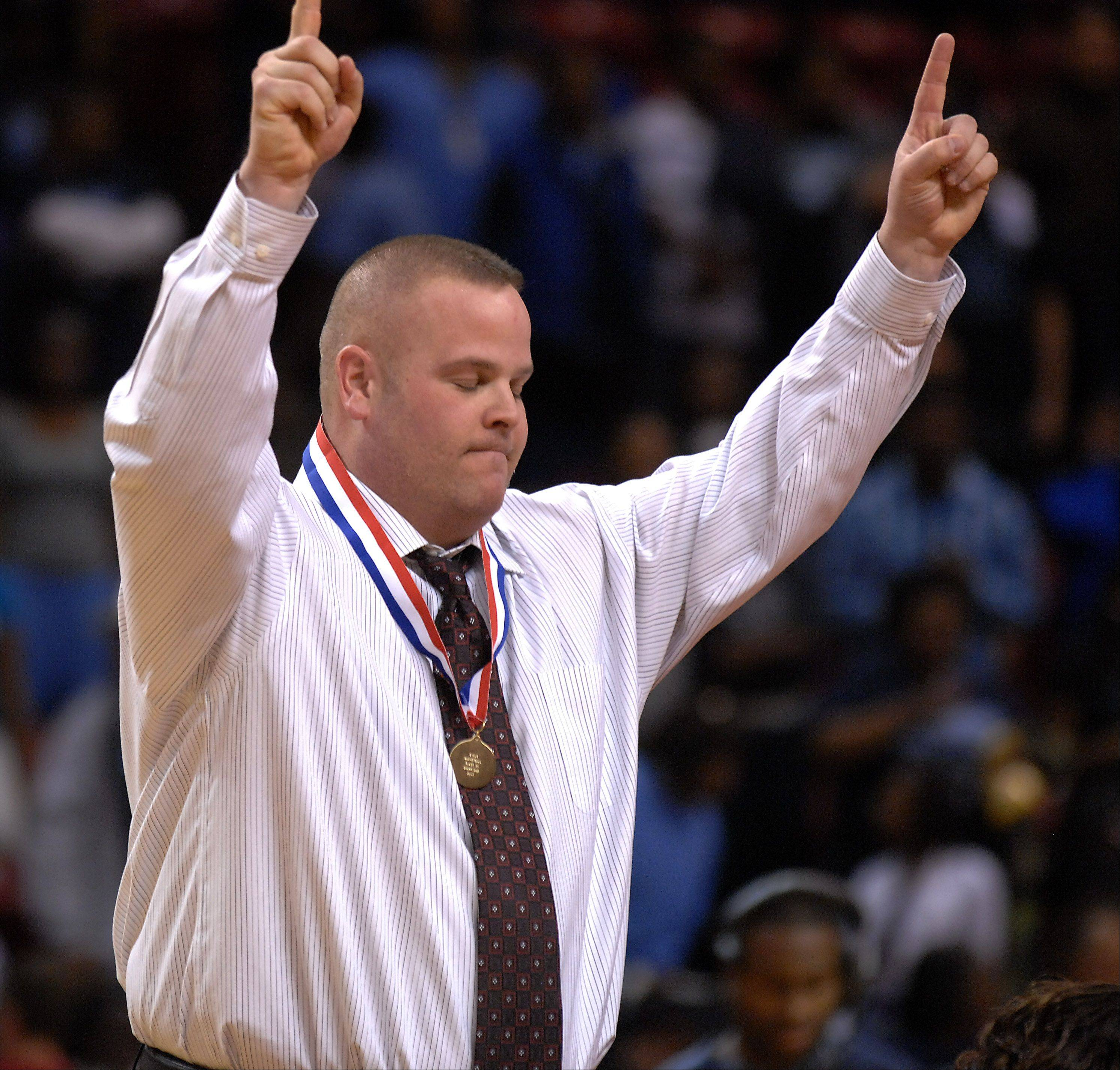 Montini's coach Jason Nichols celebrates his win over Hillcrest in the girls 4A basketball finals in Normal on Saturday.