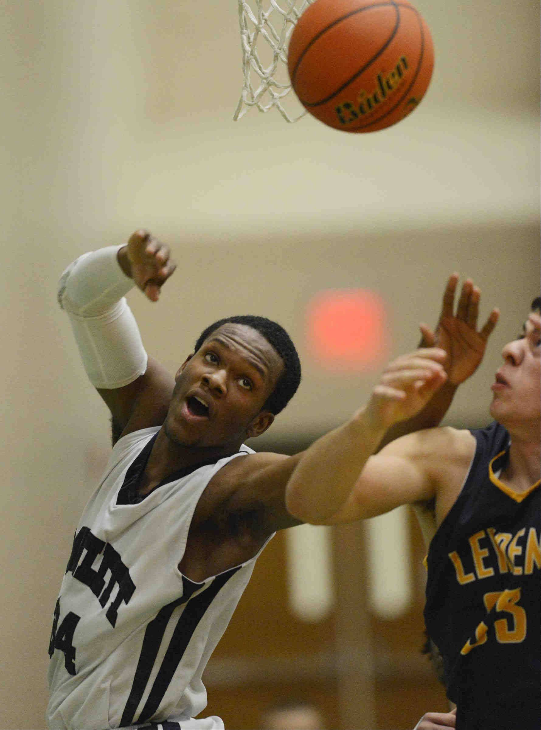Bartlett's Lance Whitaker and Leyden's Nick Best watch a loose ball.