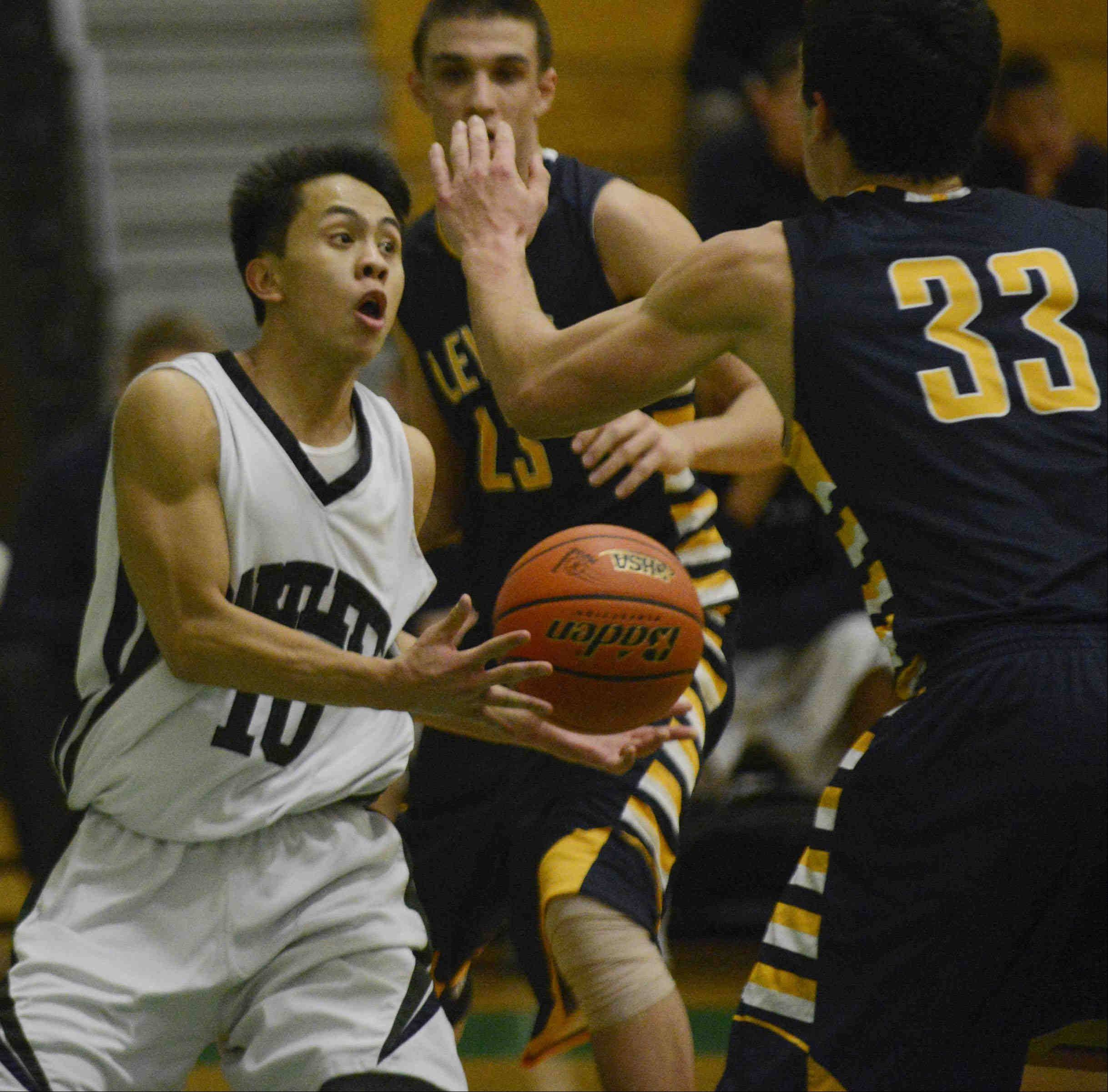 Bartlett's Marcus Aluquin dumps the ball to a teammate against Leyden.