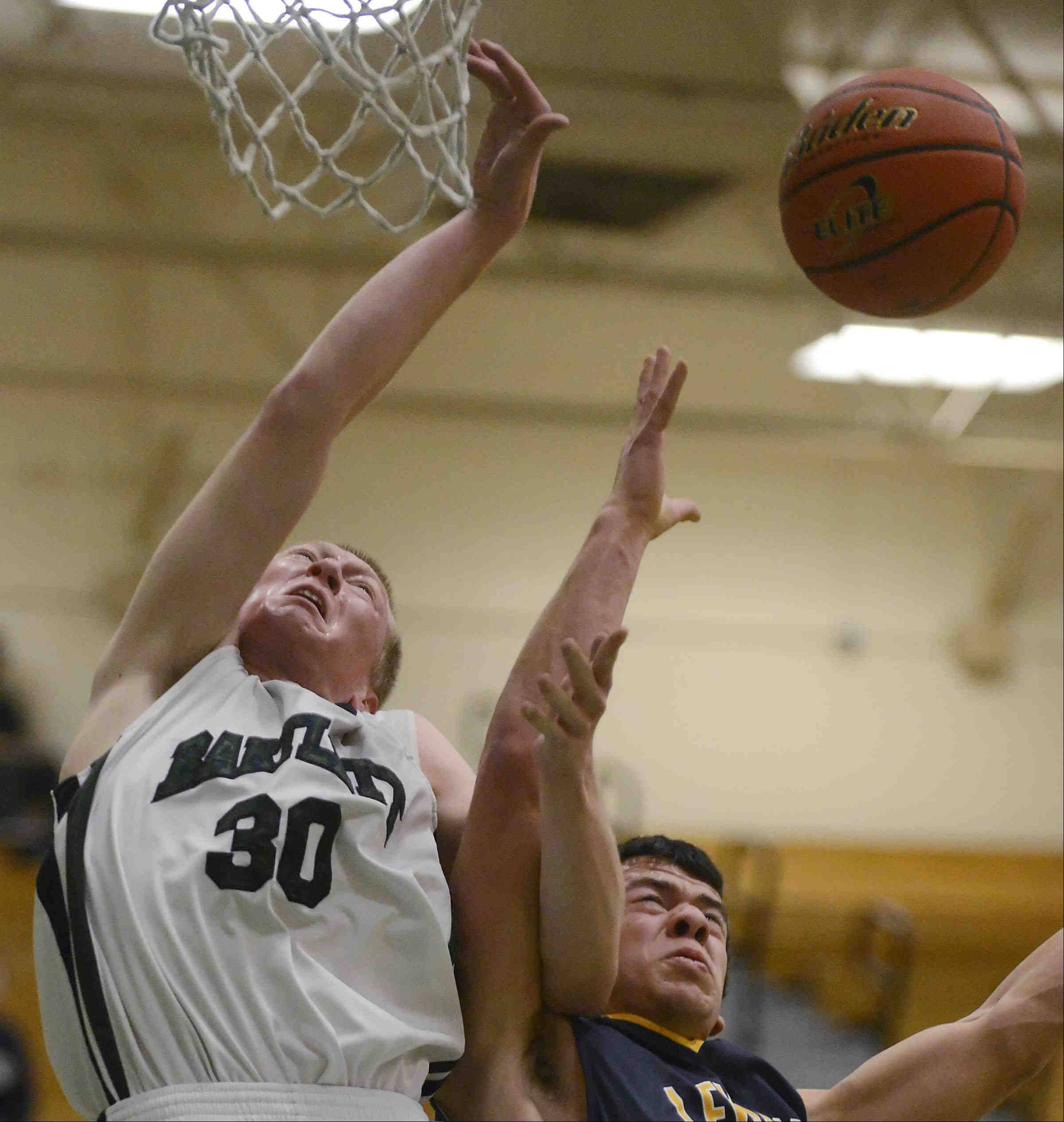 Bartlett's Billy Kramer and Leyden's Nick Best compete for a rebound.