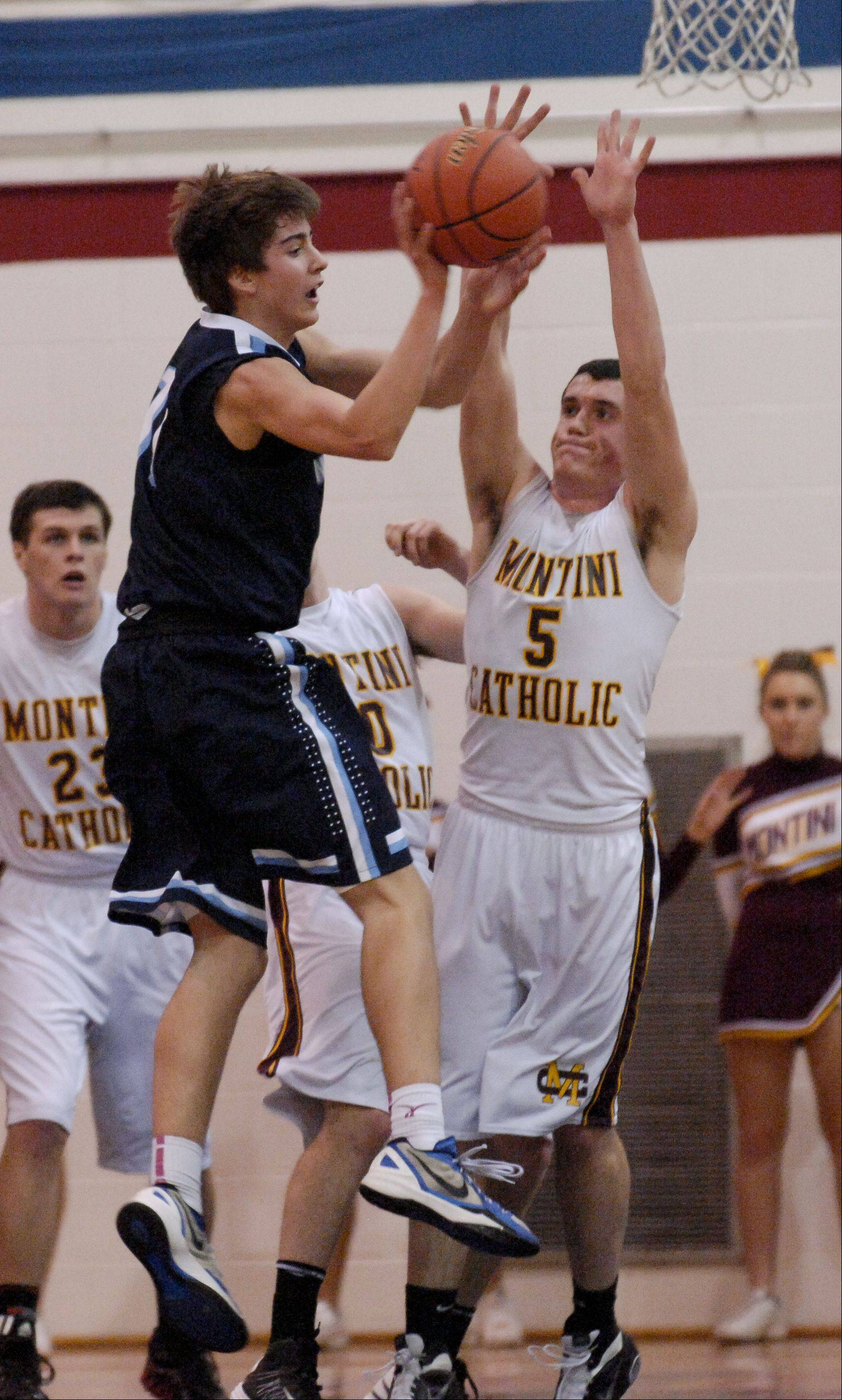 Patrick Mooney of Montini guards Kevin Connelly of Nazareth.