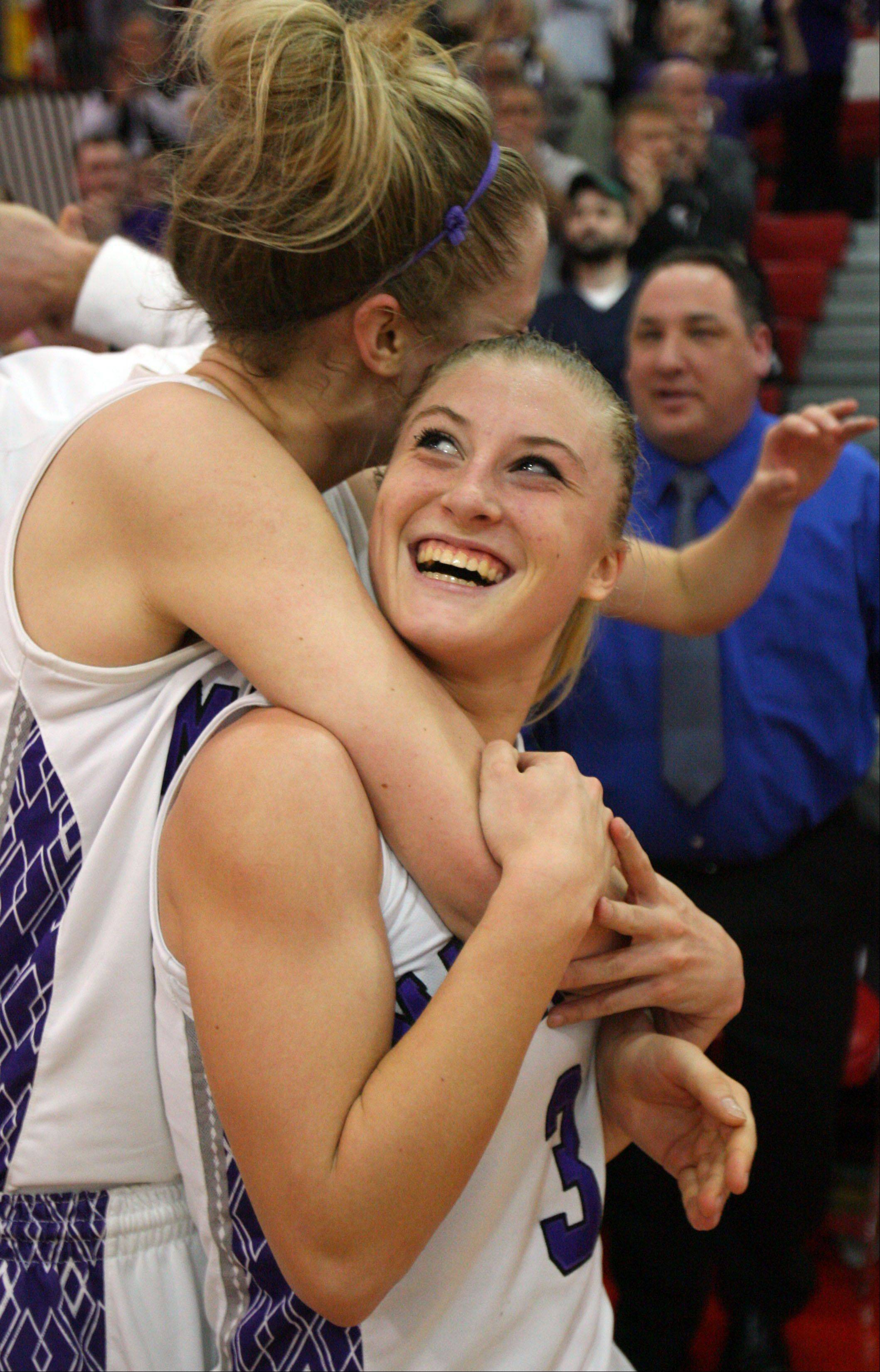 Rolling Meadows' Jenny Vliet left and Jackie Kemph celebrate after beating Evanston in Class 4A Niles West super-sectional Monday night in Skokie.