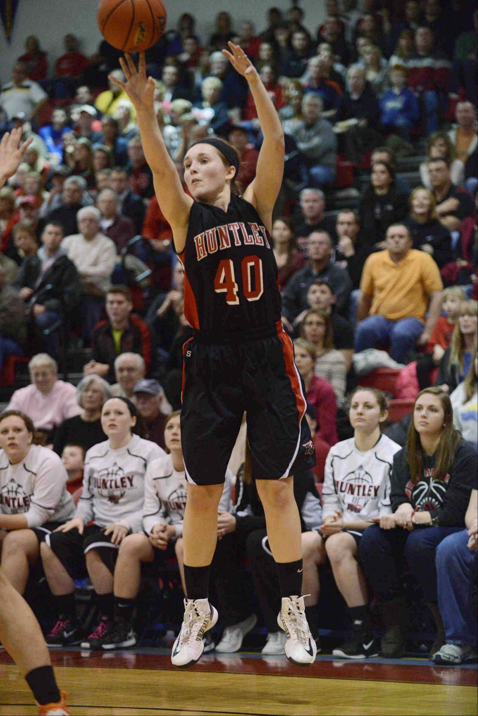 Huntley junior Sam Andrews puts up a shot during the Red Raiders' 47-43 win over Wheaton Warrenville South Monday in the Class 4A Dundee-Crown supersectional. Huntley takes on Rolling Meadows at 6:30 p.m. today in a state semifinal at Redbird Arena in Normal.