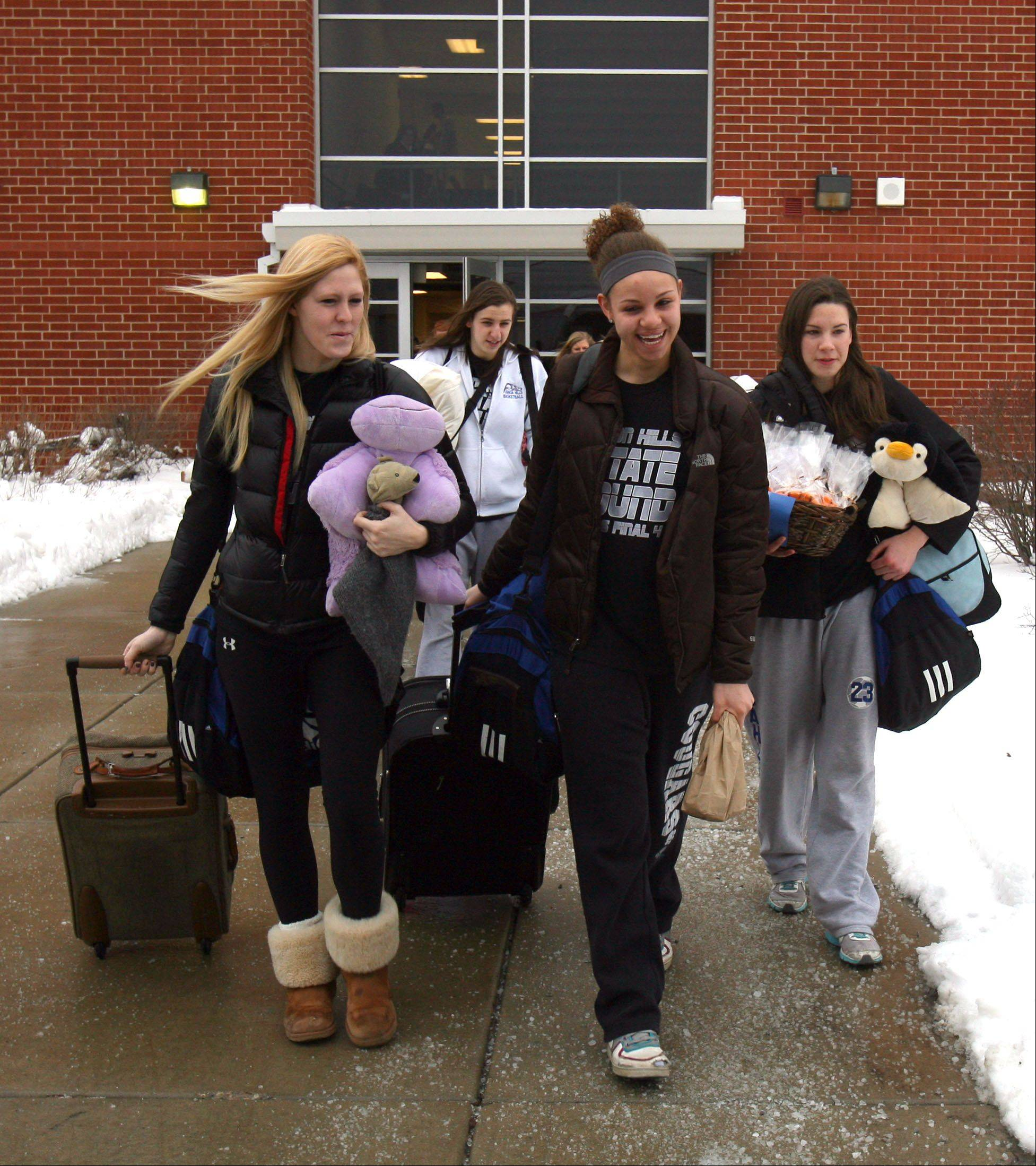 The Vernon Hills High School's girls basketball team heads to the bus that will take them to the Class 3A girls state basketball tournament at Redbird Arena in Normal this weekend.