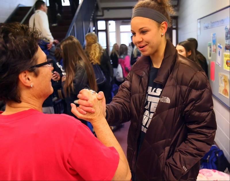 Vernon Hills High School Principal Ellen Cwick, left, gives Lauren Webb  some words of