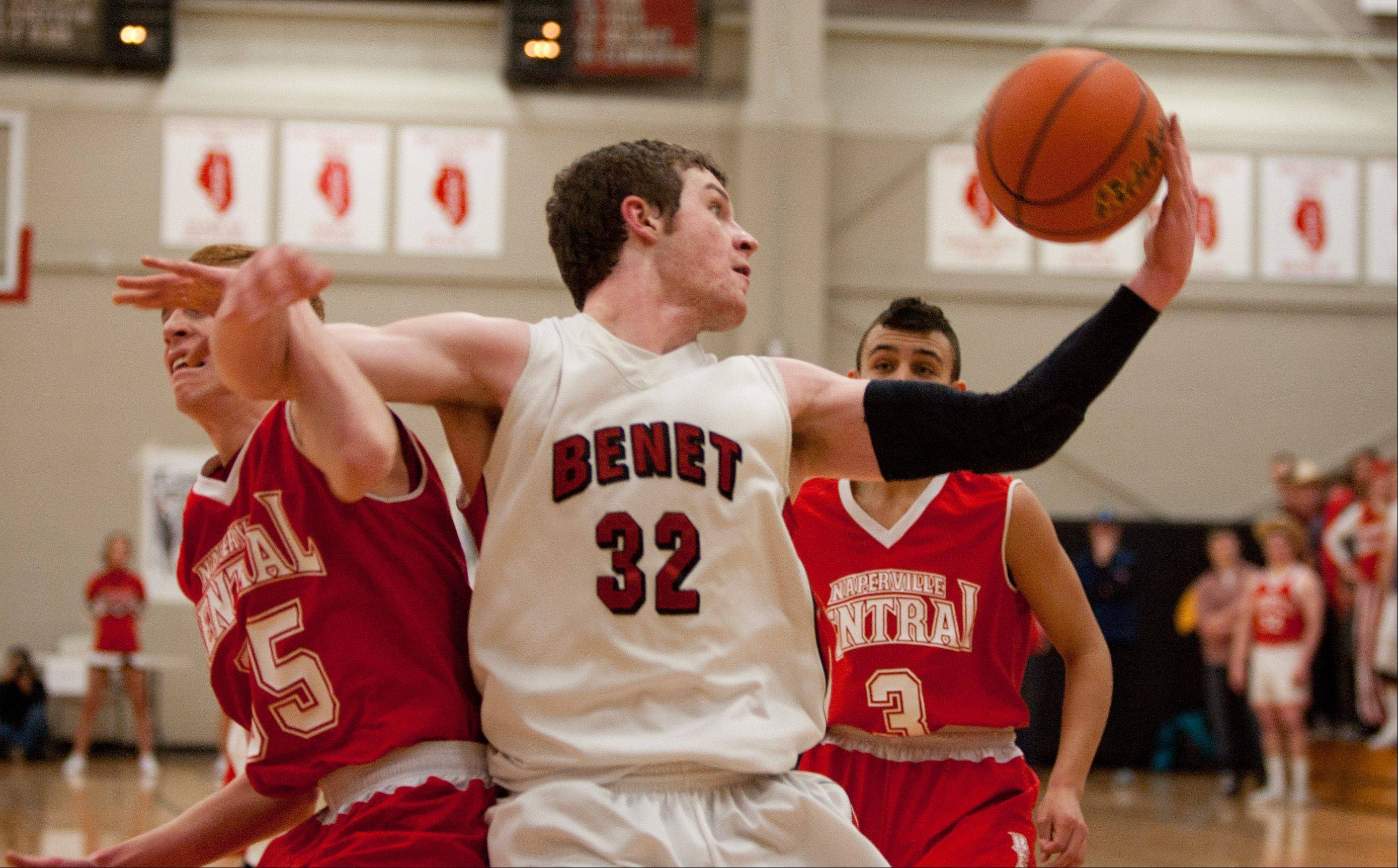 Benet's Pat McInerney (32), grabs a rebound during regional action in Lisle.