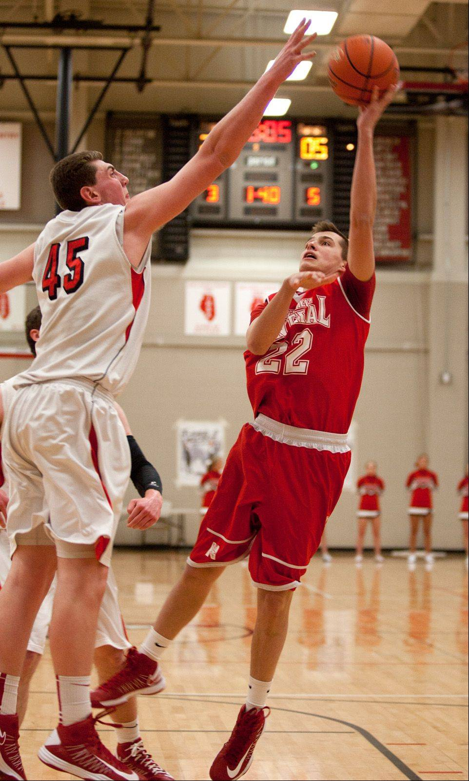 Naperville Central's Taylor Zelinski, right, shoots over Benet's Sean O'Mara, during regional action in Lisle.