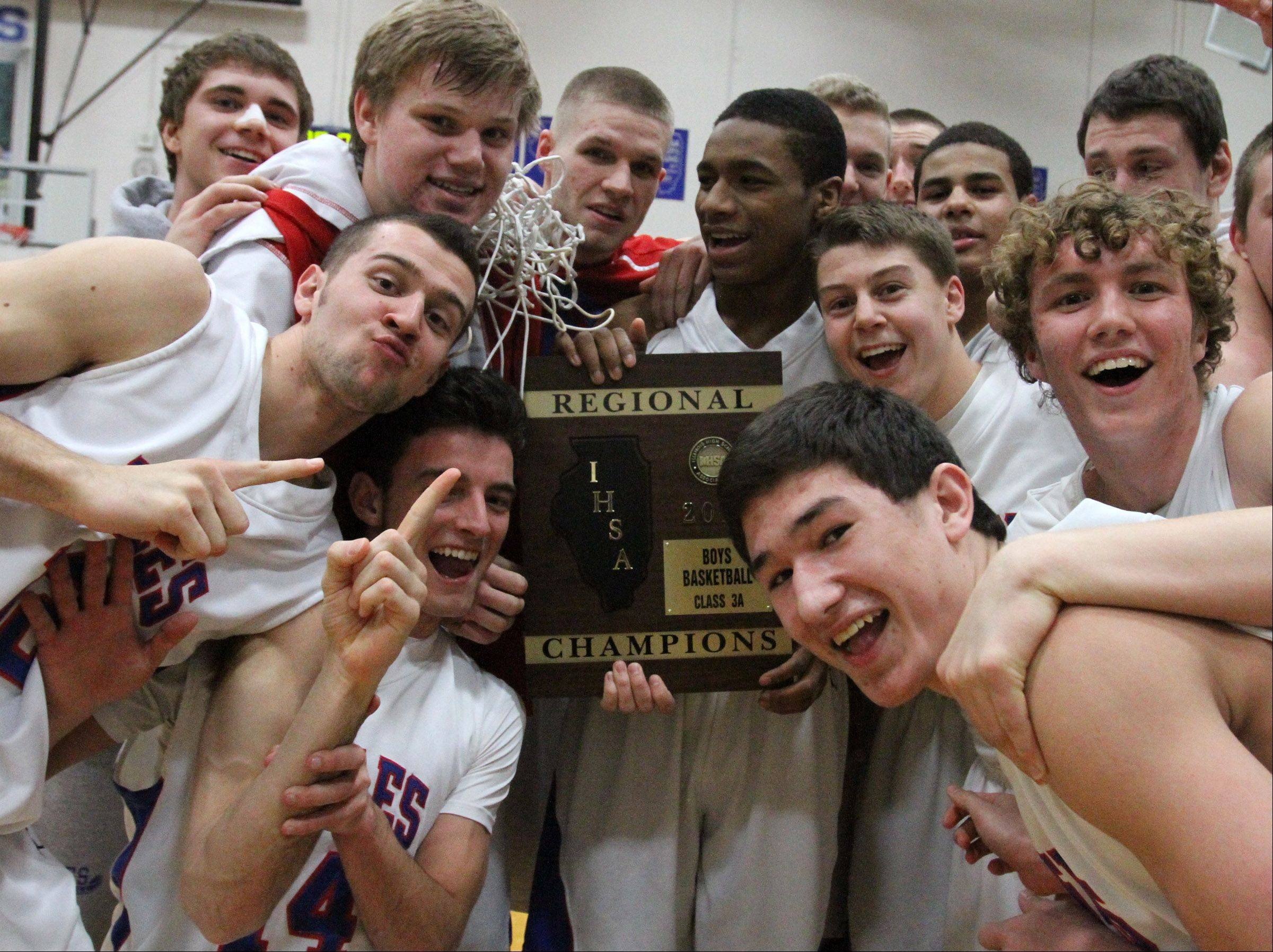 Lakes celebrates its Class 3A regional championship over Wauconda at Vernon Hills on Friday.