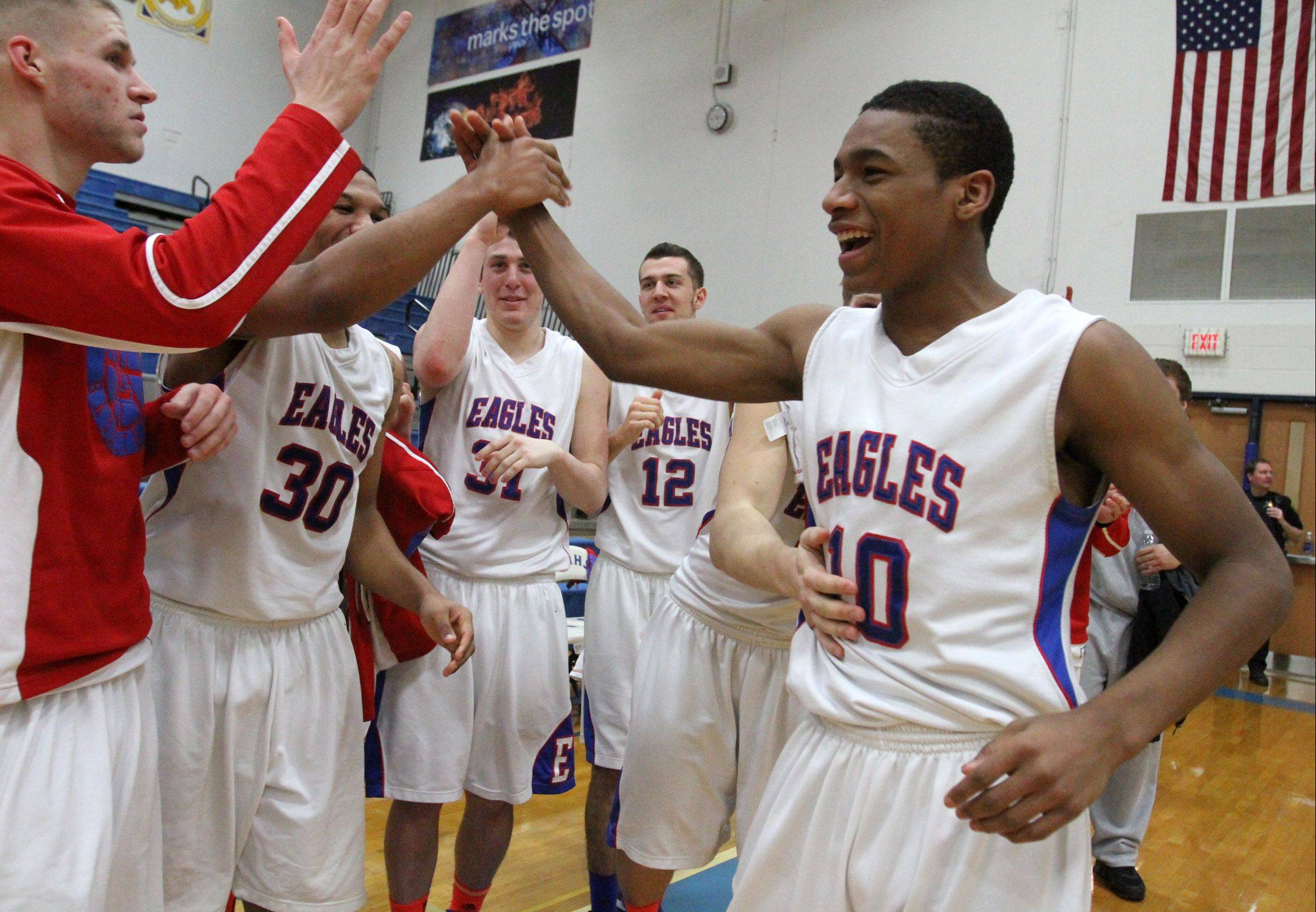 Lakes' Andrew Spencer, right, gets a high-five from teammates after the Eagles won the Class 3A regional final at Vernon Hills on Friday.