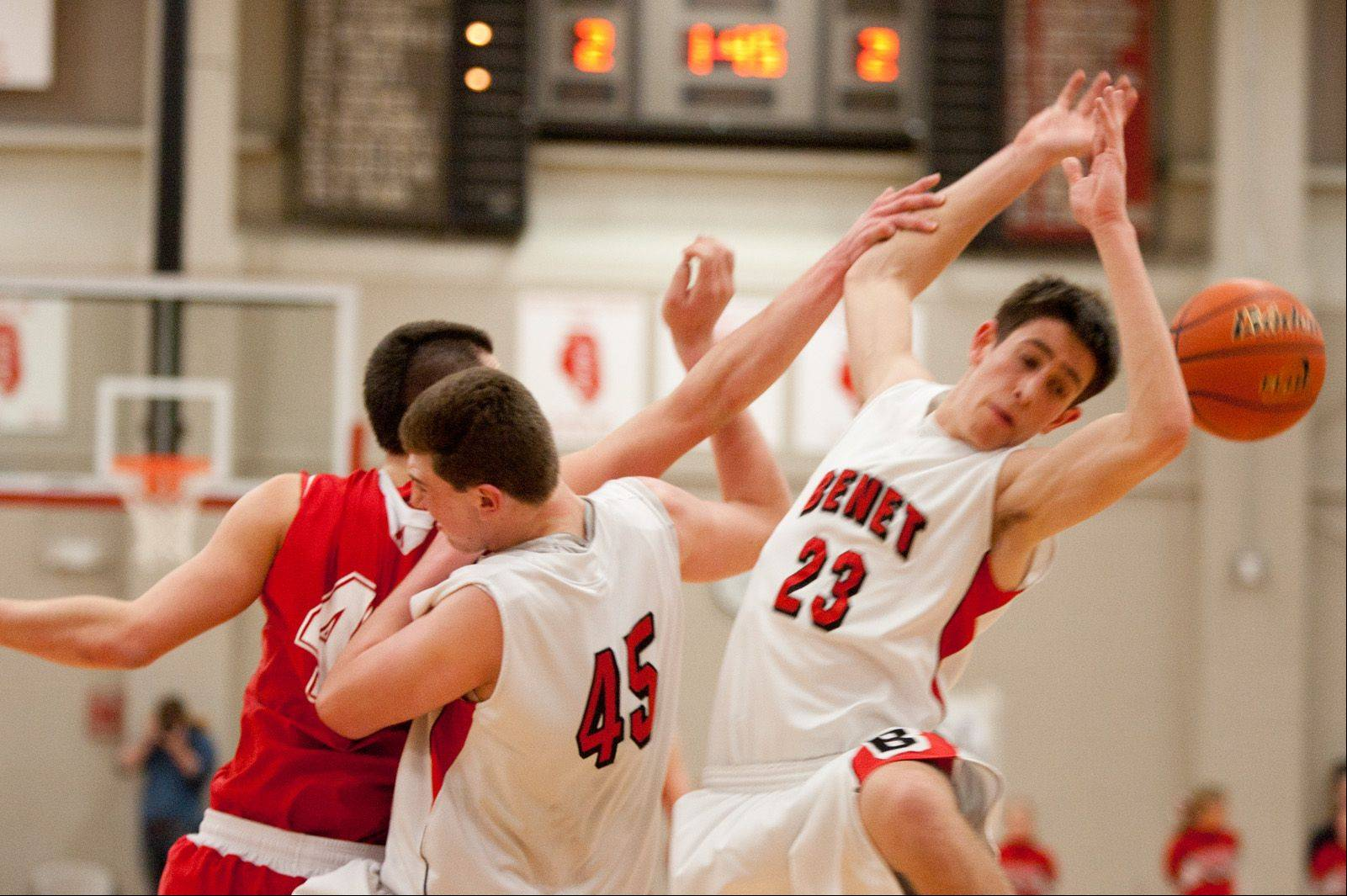 Naperville Central played Benet in the Class 4A Benet boys basketball regional final Friday night.
