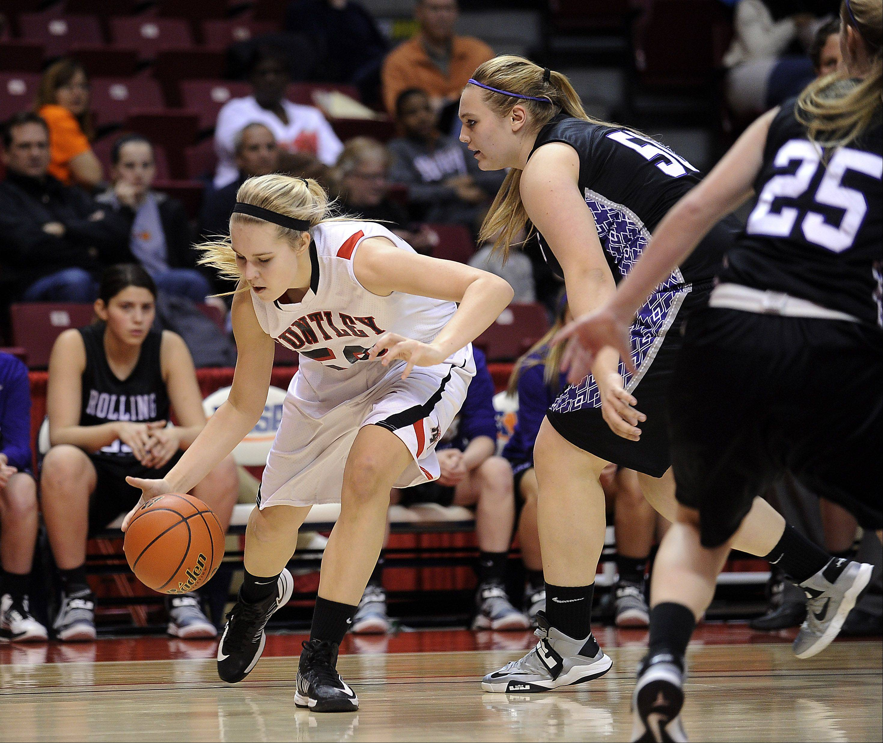 Huntley's Ali Andrews tries to get past Rolling Meadows' Morgan Keller and Allie Kemph.