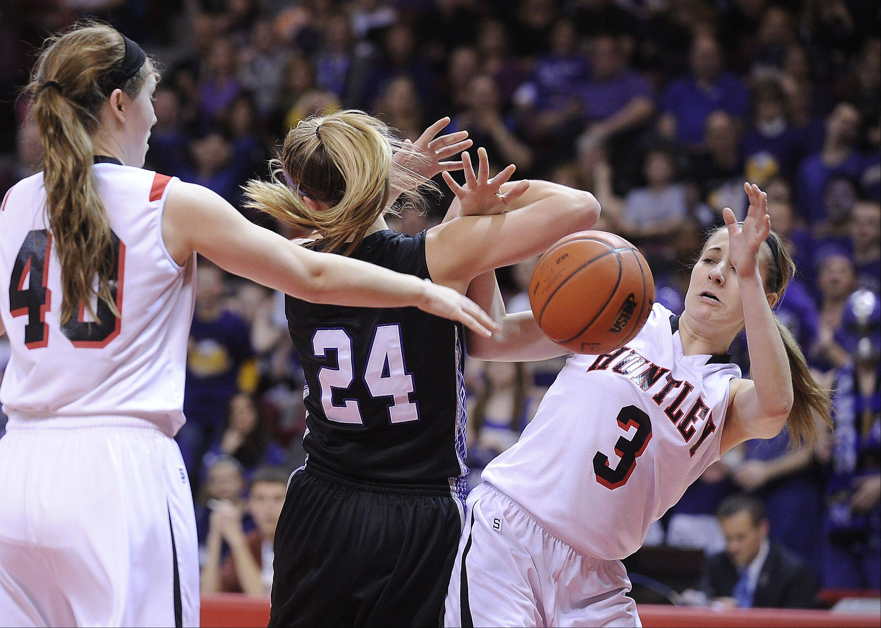 Huntley's Amanda Kaniewski and Rolling Meadows' Alexis Glasgow battle for a loose ball.