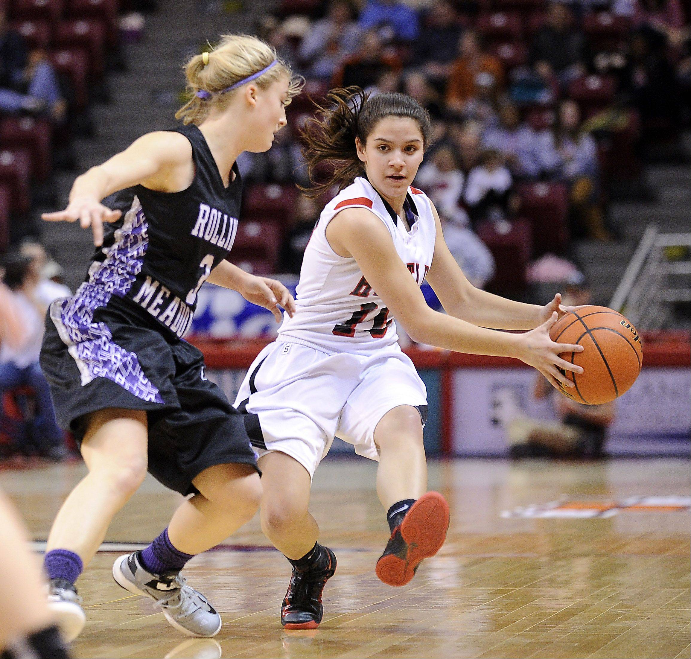 Huntley's Kayla Barreto puts on the brakes before passing the ballwhile under pressure from Rolling Meadows's Jackie Kemph.