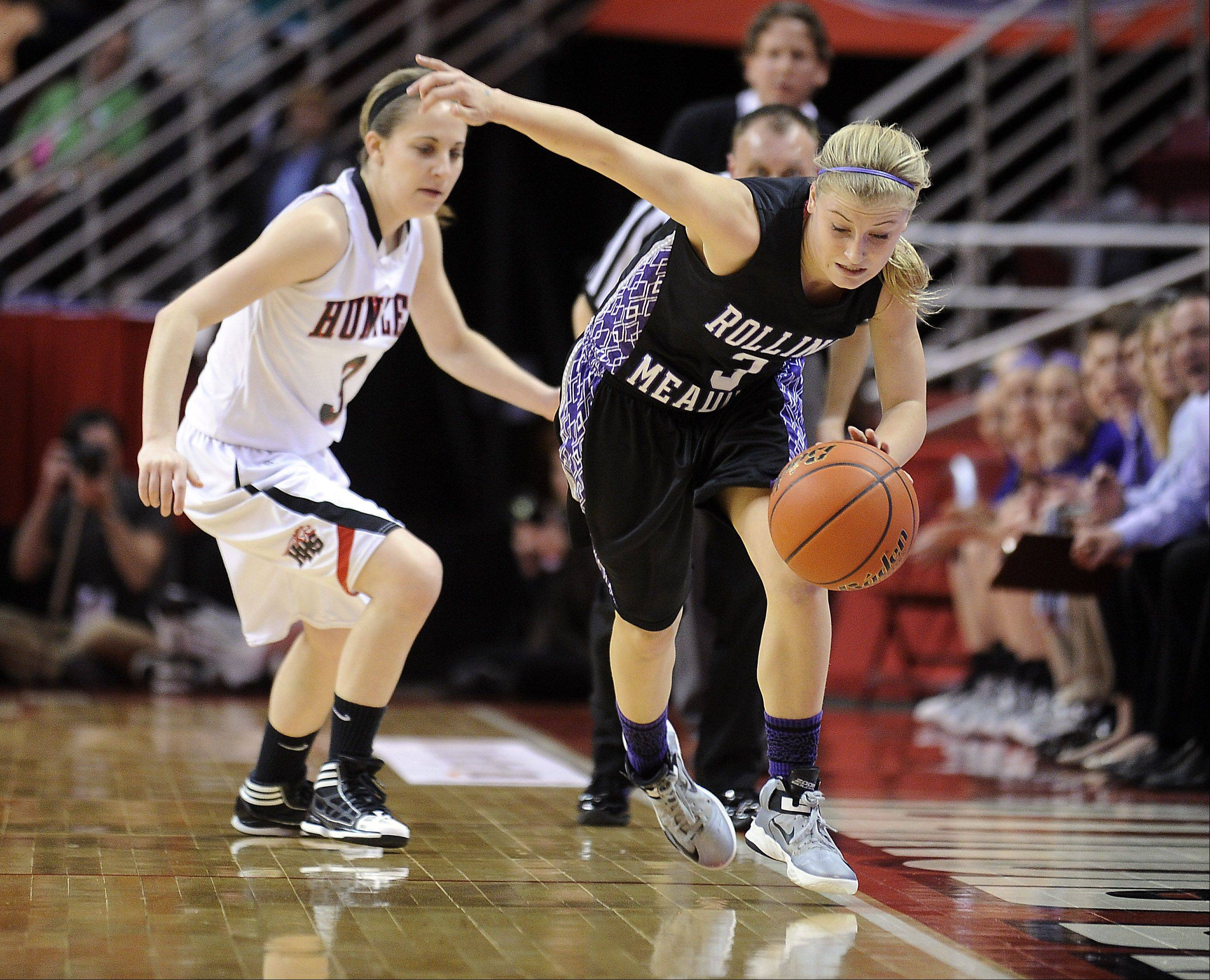 Rolling Meadows' Jackie Kemph tries to keep the ball in play as Huntley's Amanda Kaniewski applies pressure during the Class 4A girls basketball semifinals in Normal on Friday.