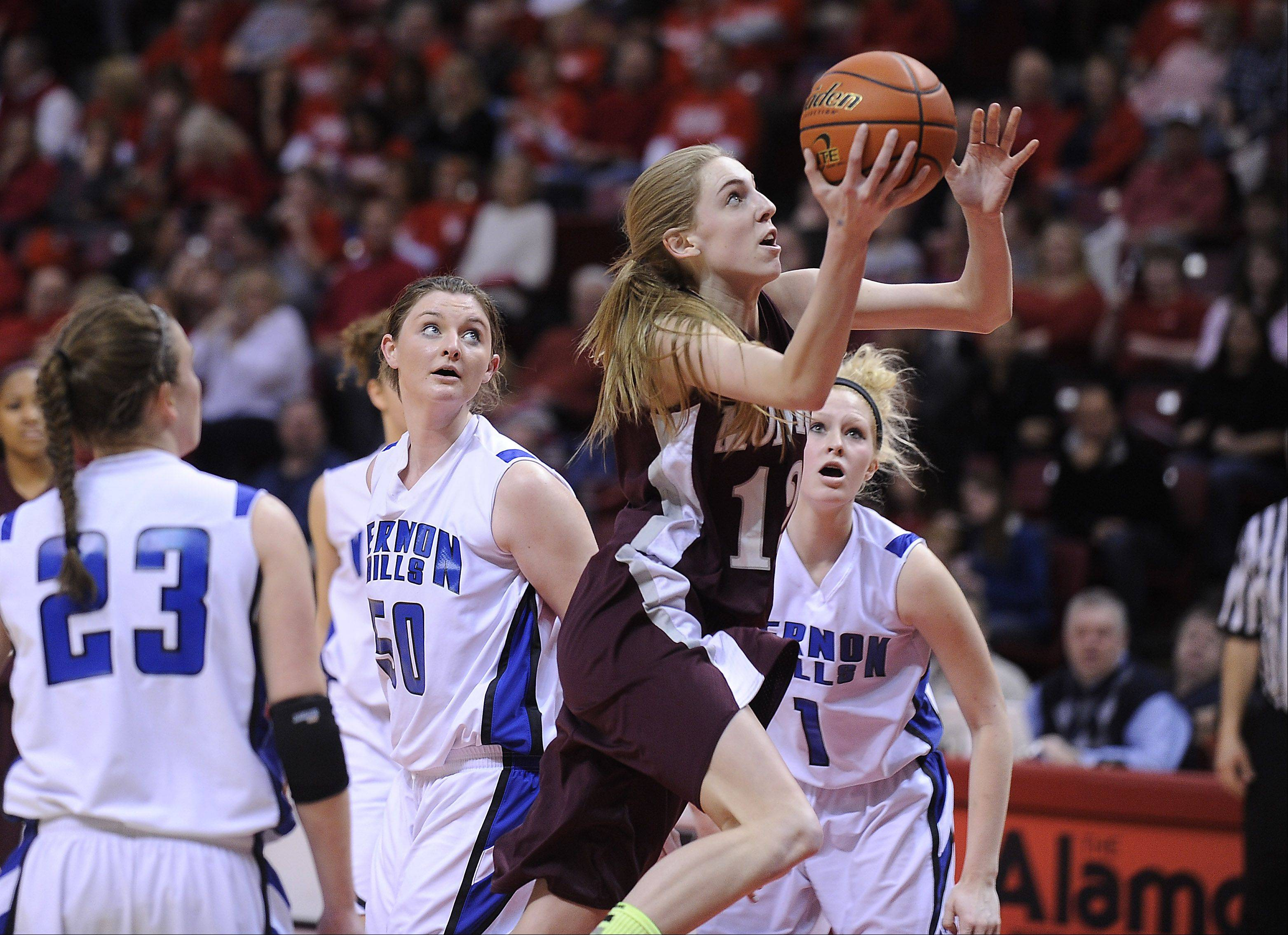 Montini's Kelly Karlis eyes the basket in the third quarter.