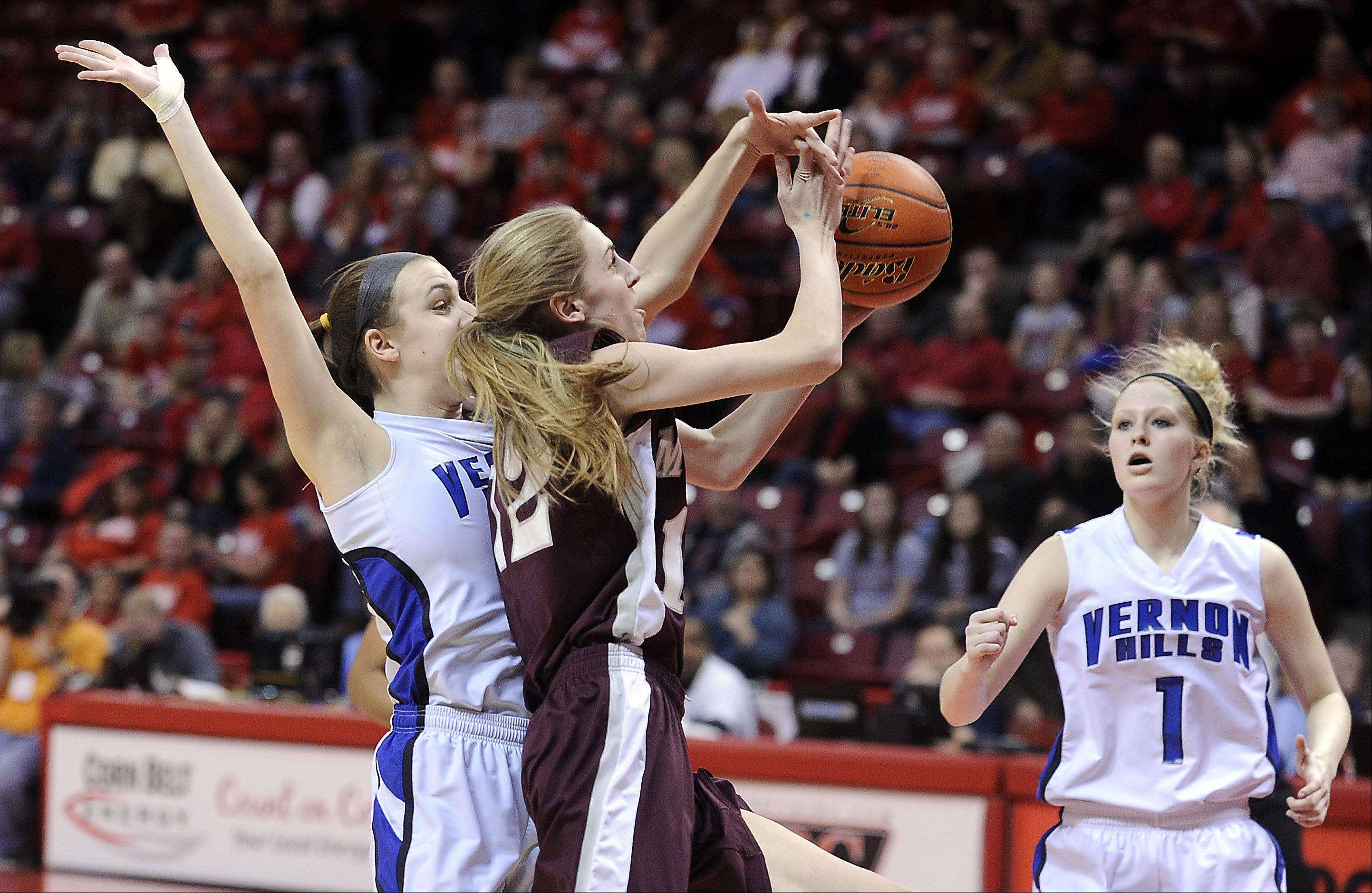 Vernon Hills Alina Lehocky fouls Montini's Kelly Harris in the third quarter.