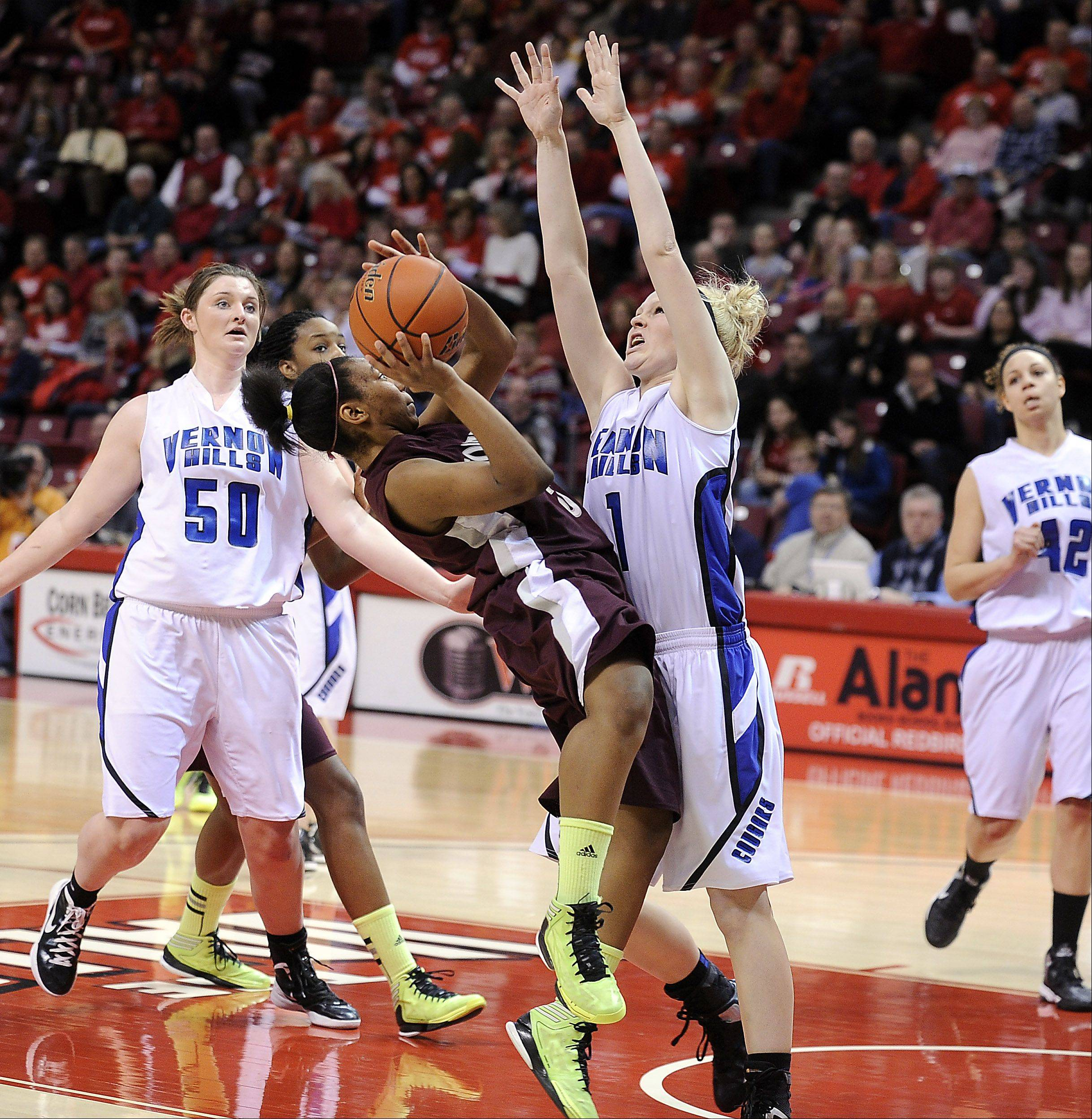 Vernon Hills Sydney Smith blocks the shot of Montini's Tiara Wallace in the third quarter.