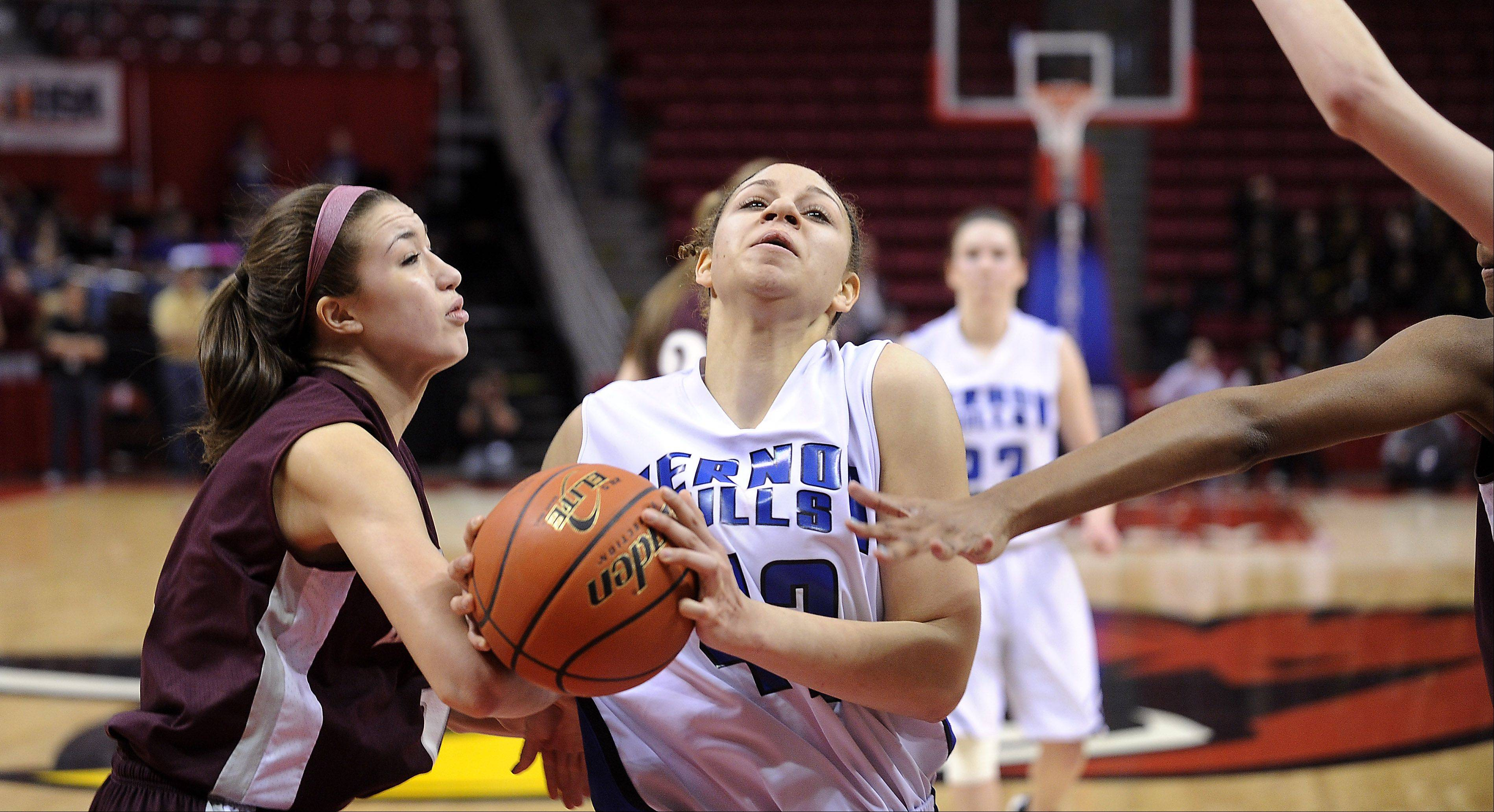 Vernon Hills' Lauren Webb is fouled in the fourth quarter by Montini's Kelsey Bogdan and Kelly Harris.