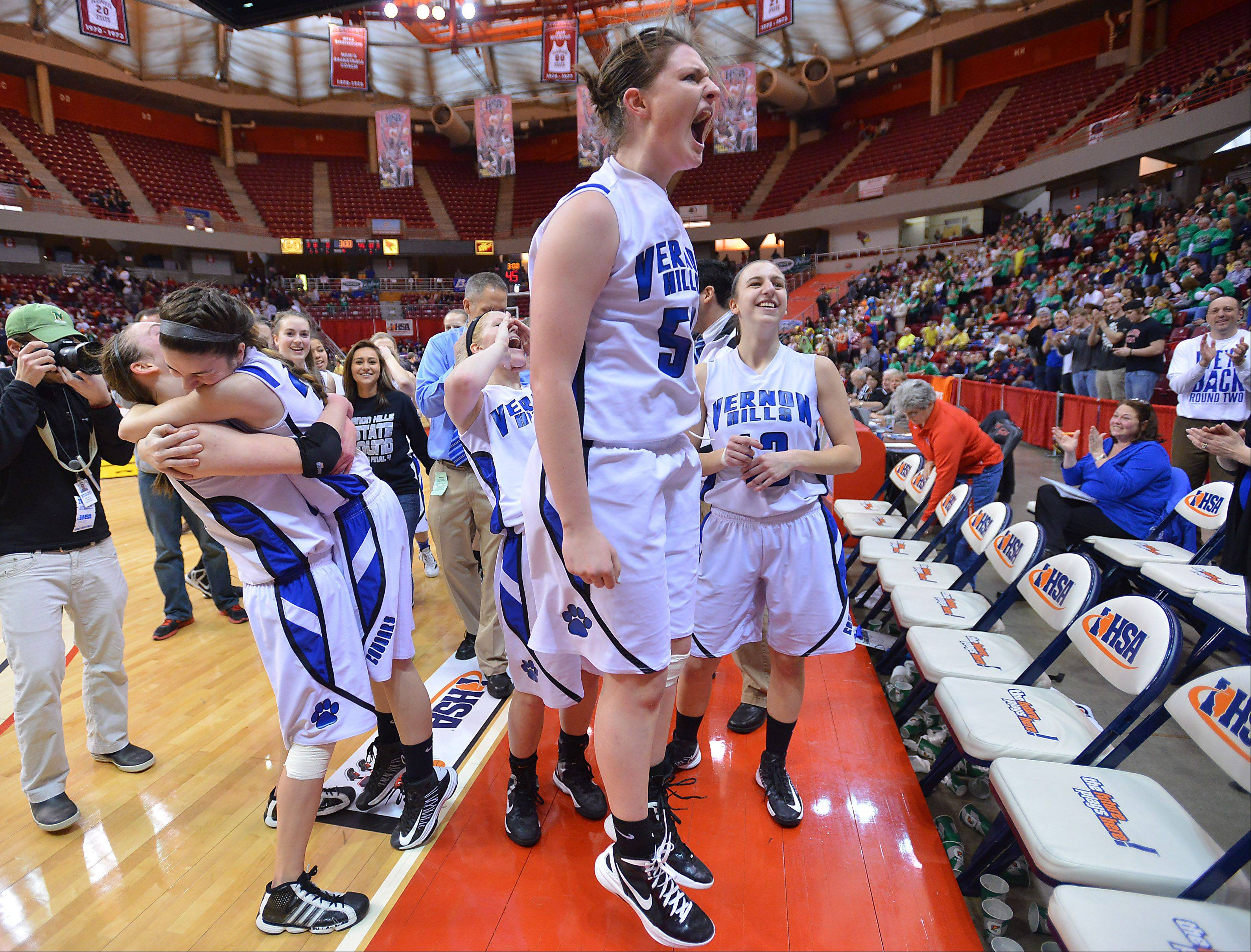 Vernon Hills Meri Bennett-Swanson jumps for joy with the rest of her teammates after their overtime win against Montini in the class 3A semifinal game Friday in Normal.