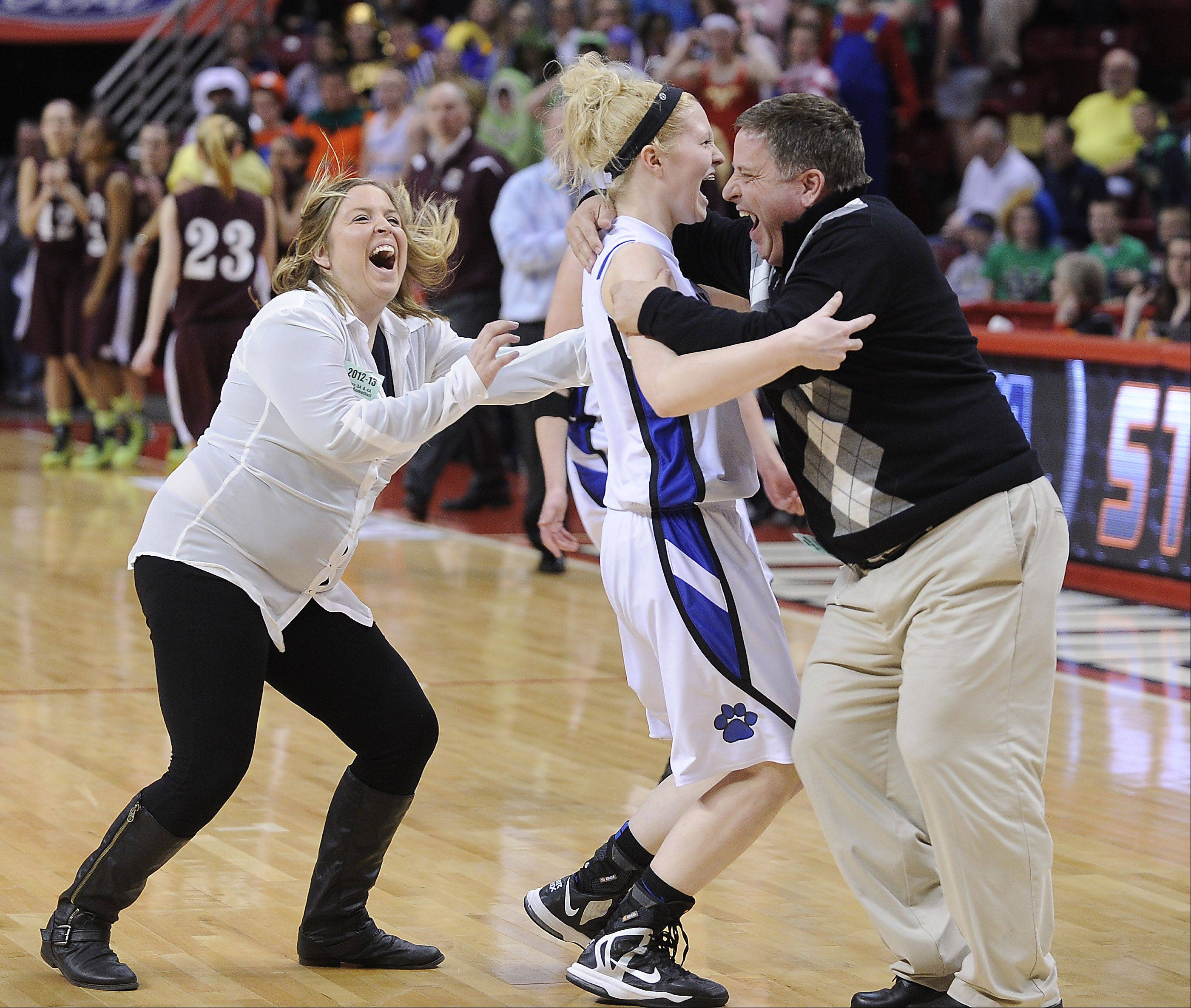Vernon Hills Sydney Smith celebrates with her coaches after they beat Montini in overtime in the class 3A semifinal game Friday in Normal.