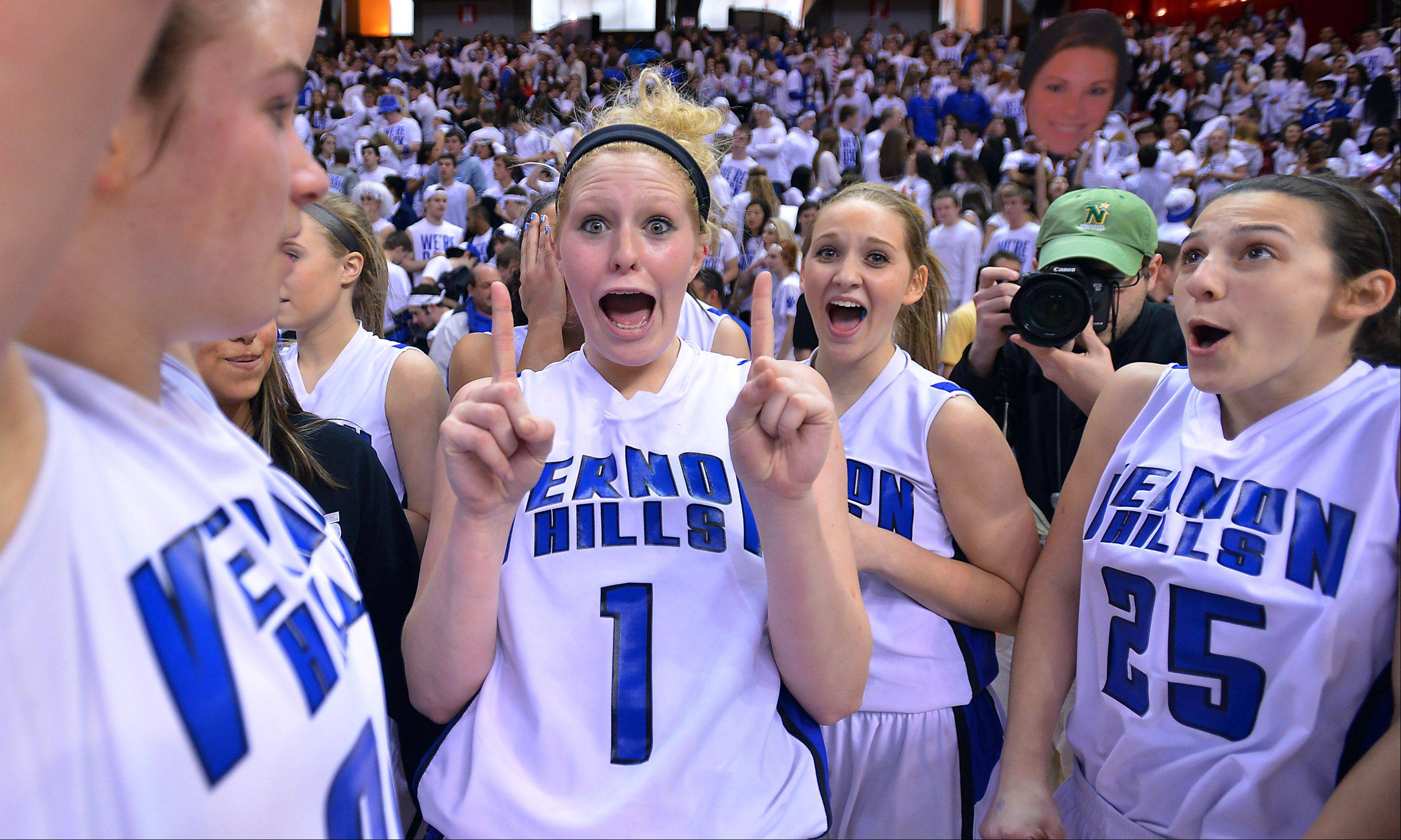 Vernon Hills Sydney Smith shows the world who is number one after they won in overtime against Montini in the class 3A semifinal game Friday in Normal.