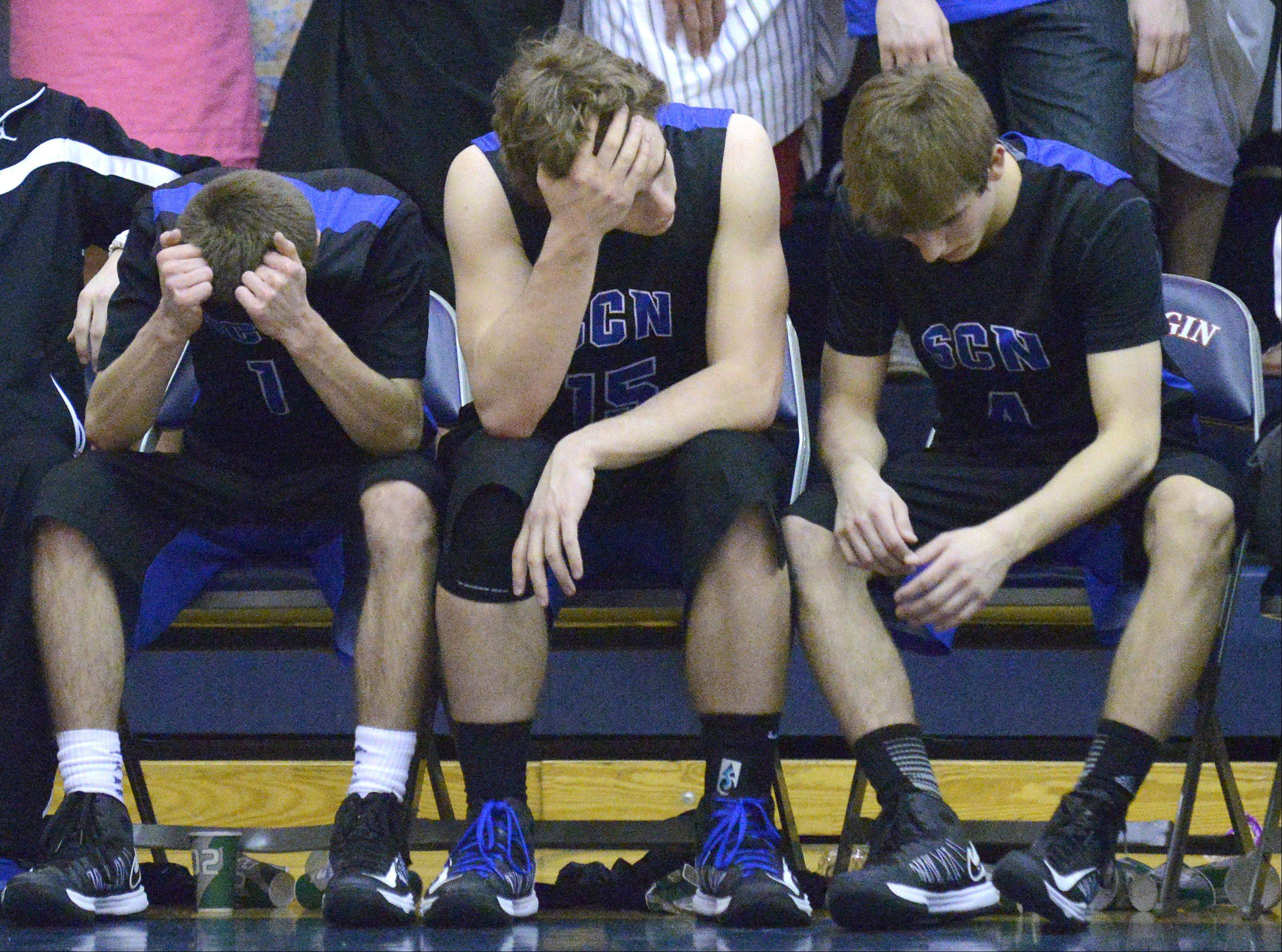 St. Charles North's Alec Goetz, Erik Miller and Jake Ludwig react as the final seconds on the clock wind down.