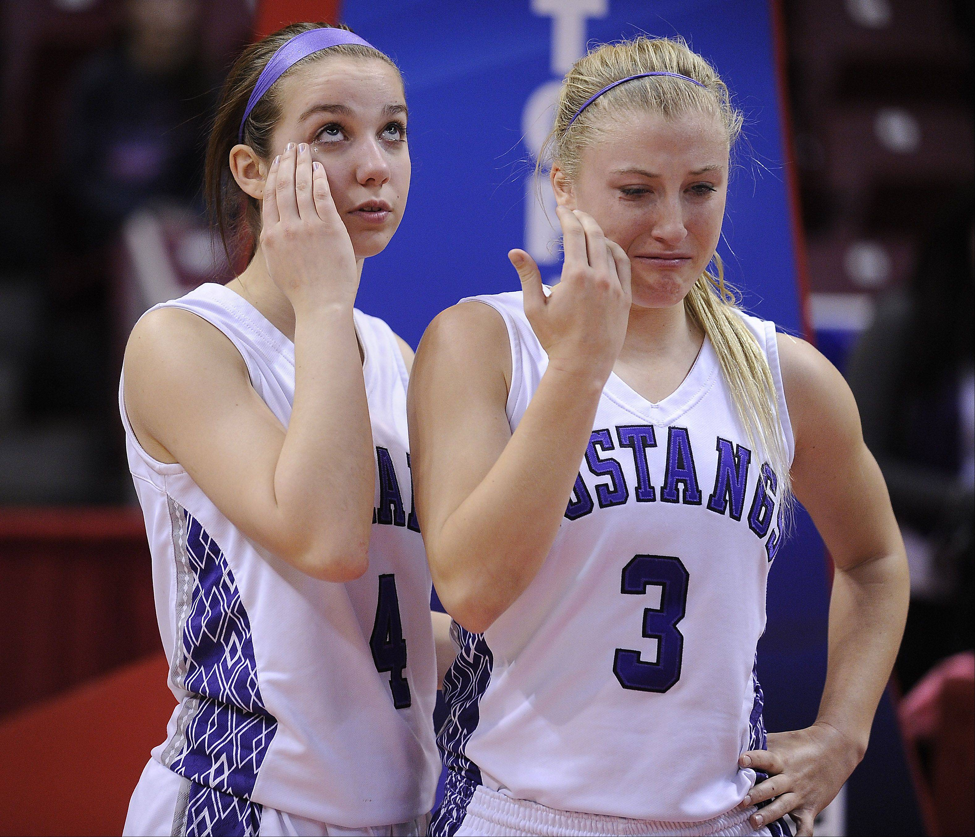 Rolling Meadows Jackie Kemph (right) and teammate Sami Kay feel the sting of getting beat by buzzer beater shot by Marian in the final second in the Class 4A 2013 girls basketball championship game in Normal on Saturday.