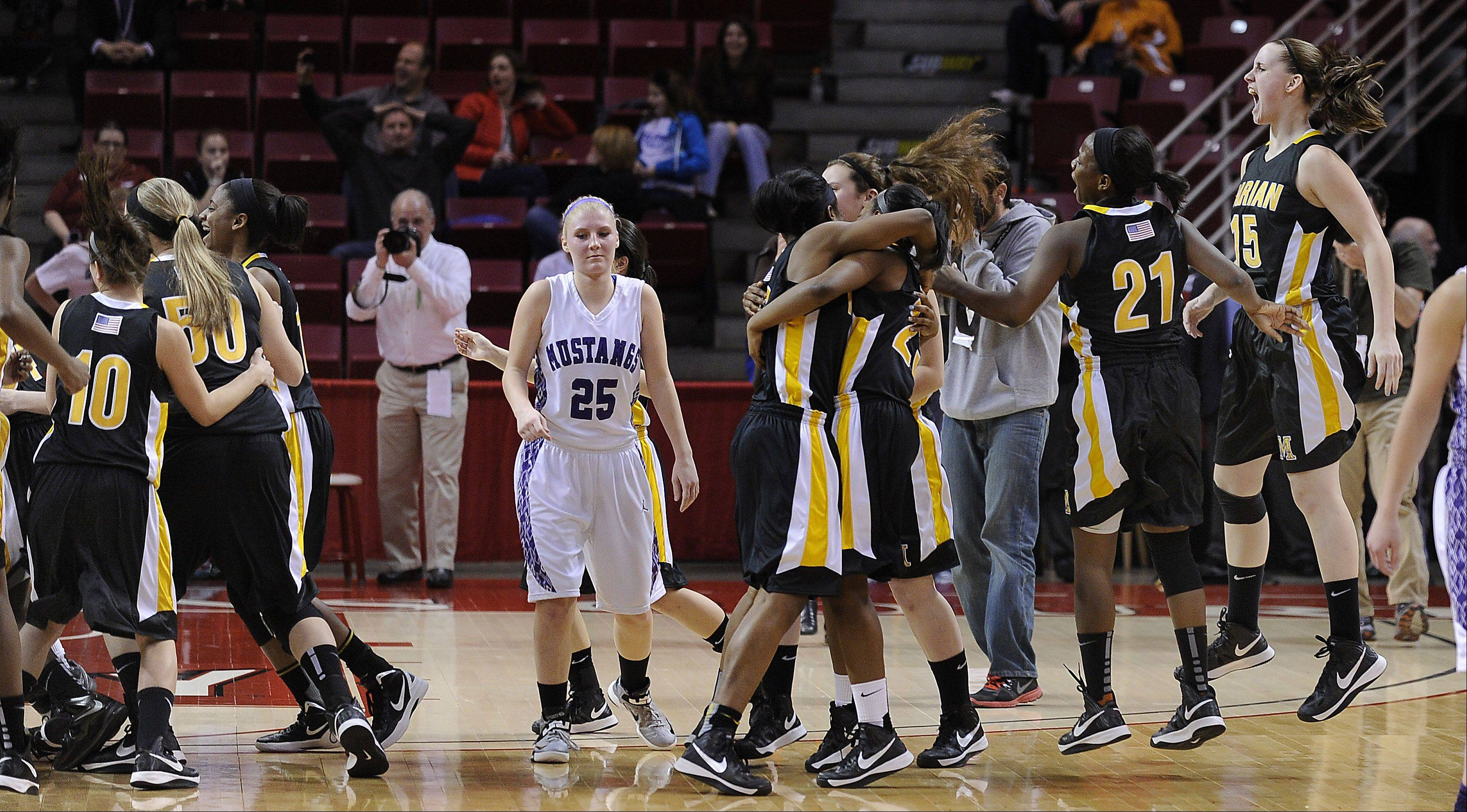 Rolling Meadows Allie Kemph walks off the court stunned as Marian celebrates their buzzer beater victory in the Class 4A 2013 girls basketball championship game in Normal on Saturday.