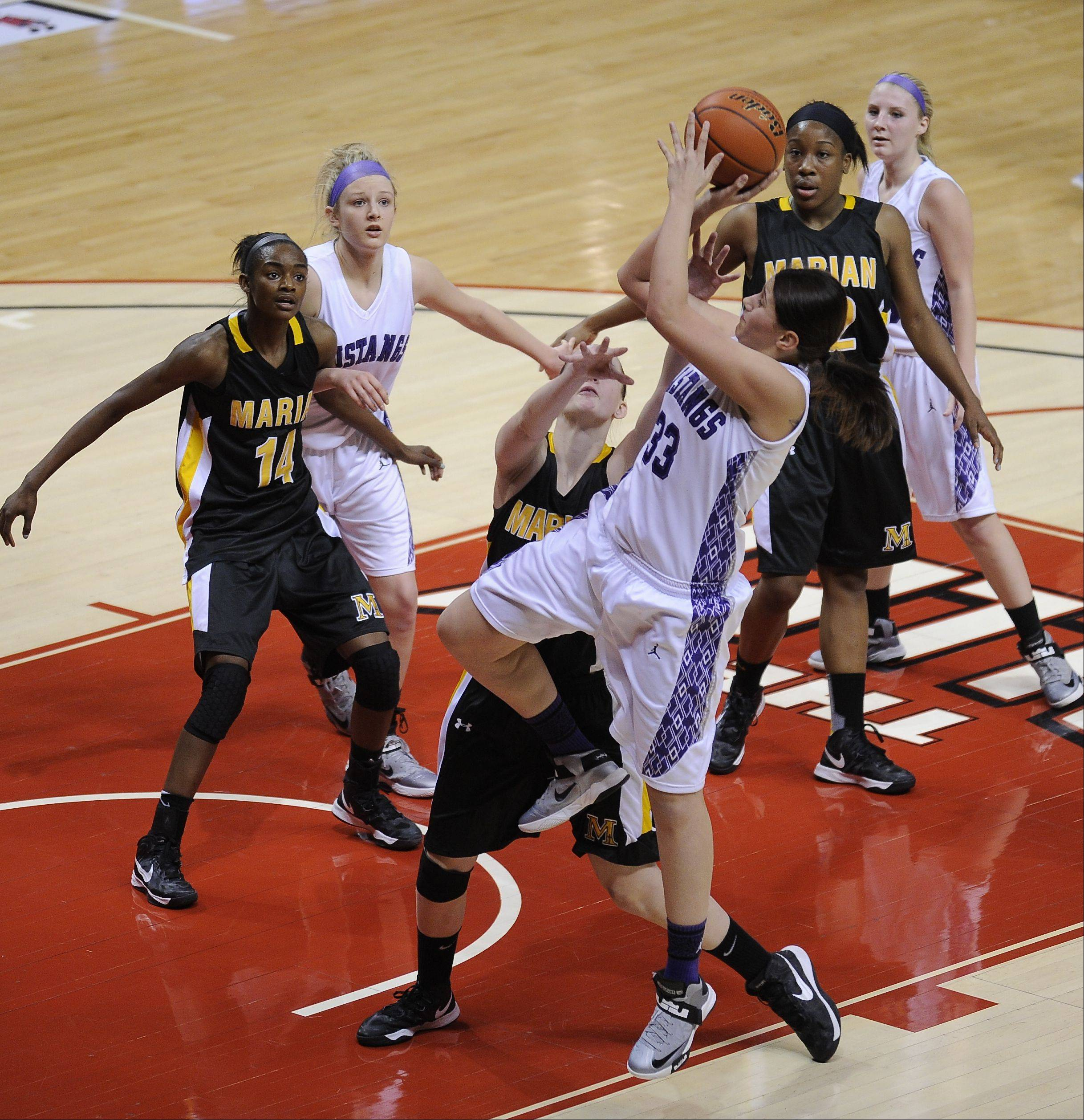 Images from the IHSA Class 4A state girls basketball championship game Rolling Meadows vs Chicago Heights (Marian) on Saturday, March 2 at the Redbird Arena in Normal.
