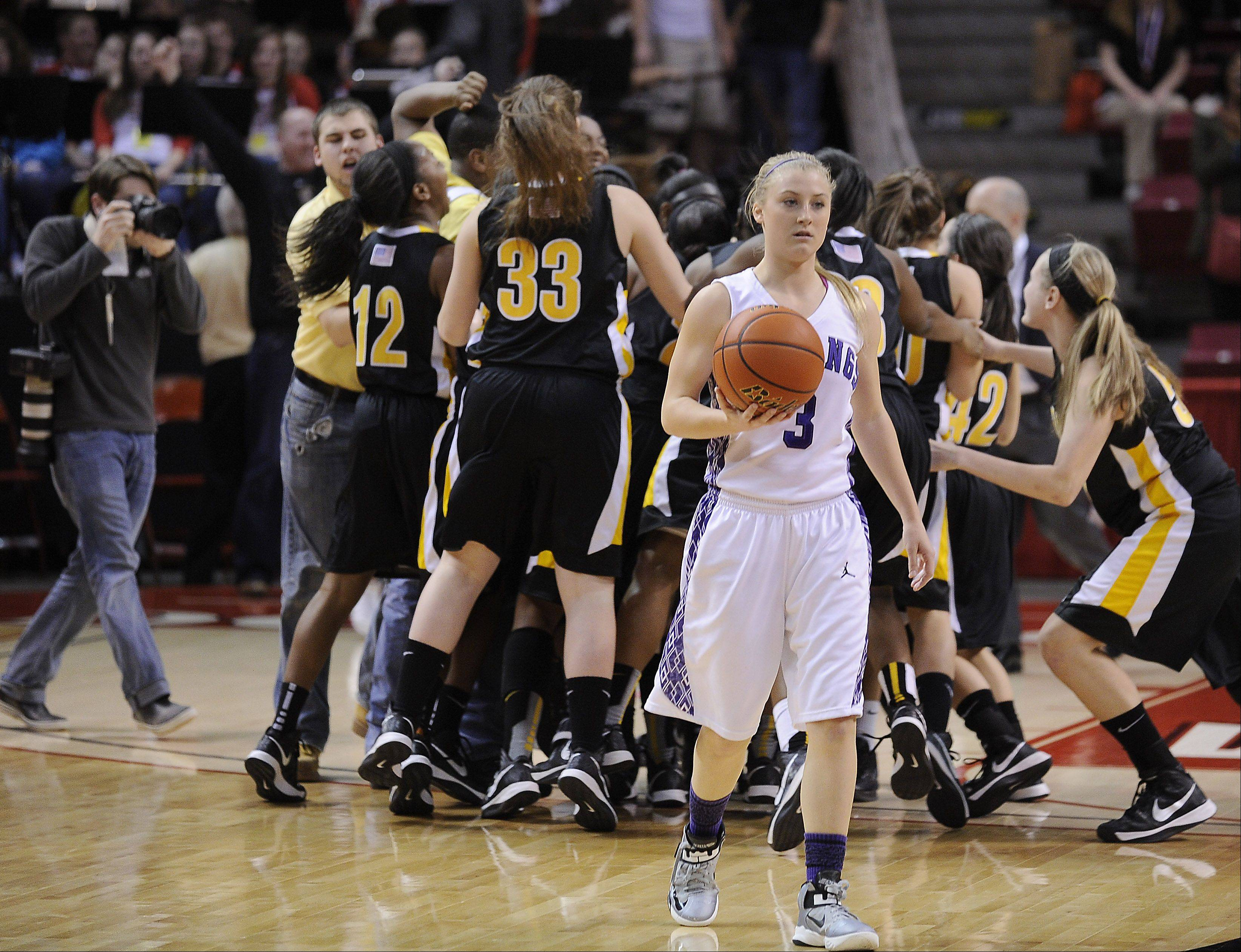 Rolling Meadows' Jackie Kemph leaves the court after Marian Catholic's last-second victory in the Class 4A girls basketball state championship game Saturday in Normal.