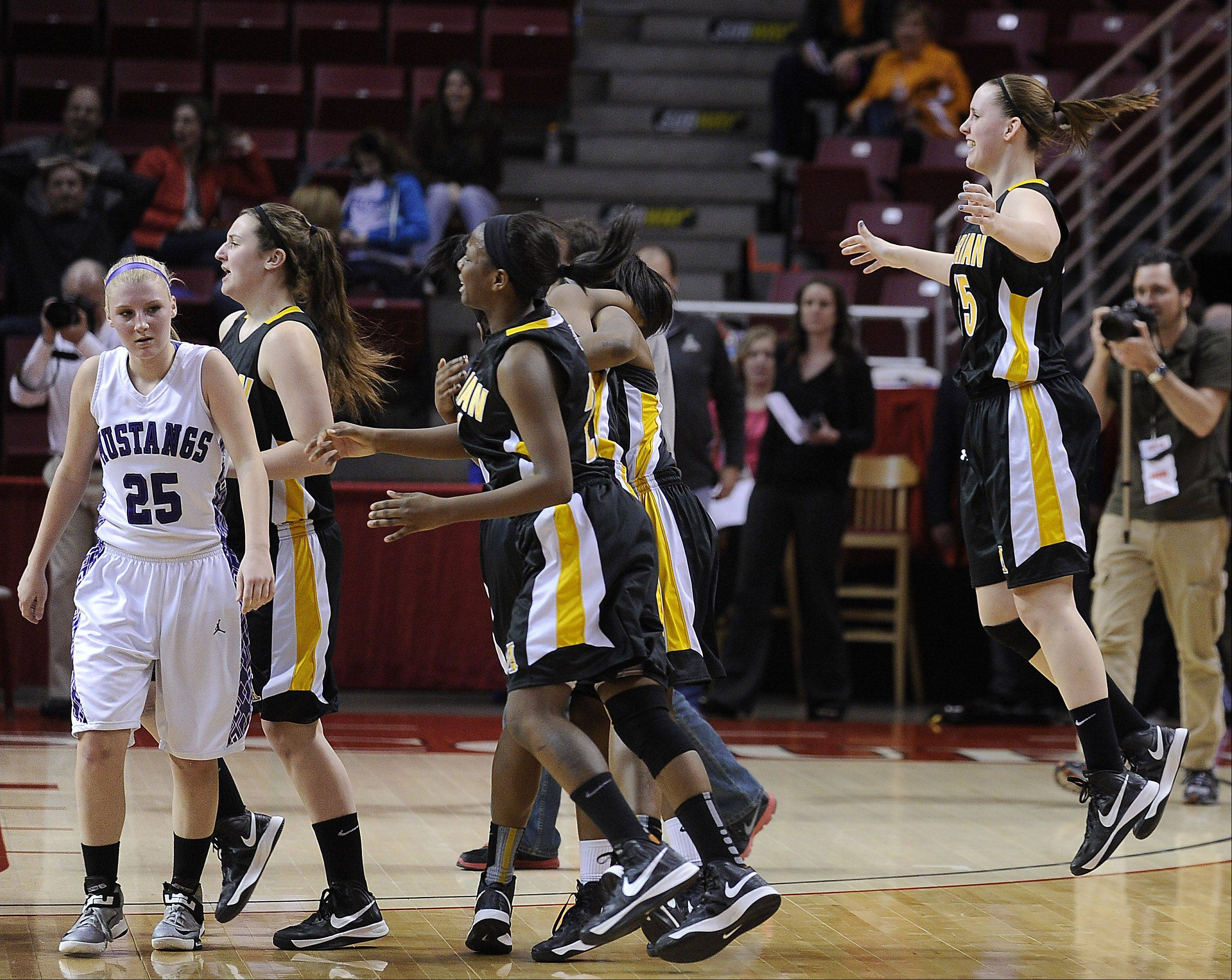 Rolling Meadows Allie Kemph leaves the court in the moments following Marian Catholic's victory in the Class 4A championship game Saturday in Normal.