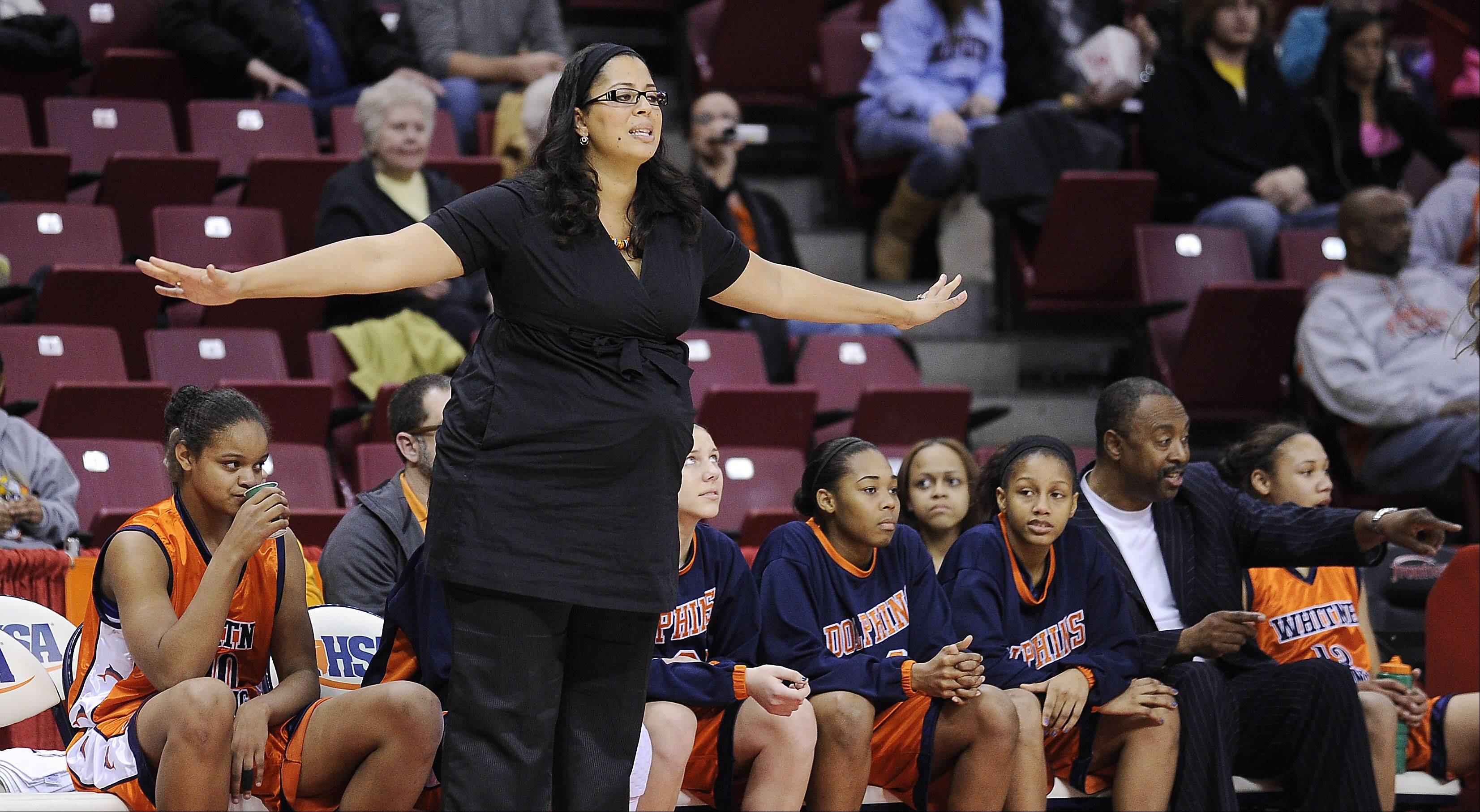 Whitney Young coach Corry Irvin directs her players to a Class 4A third-place finish against Huntley on Saturday at Redbird Arena.