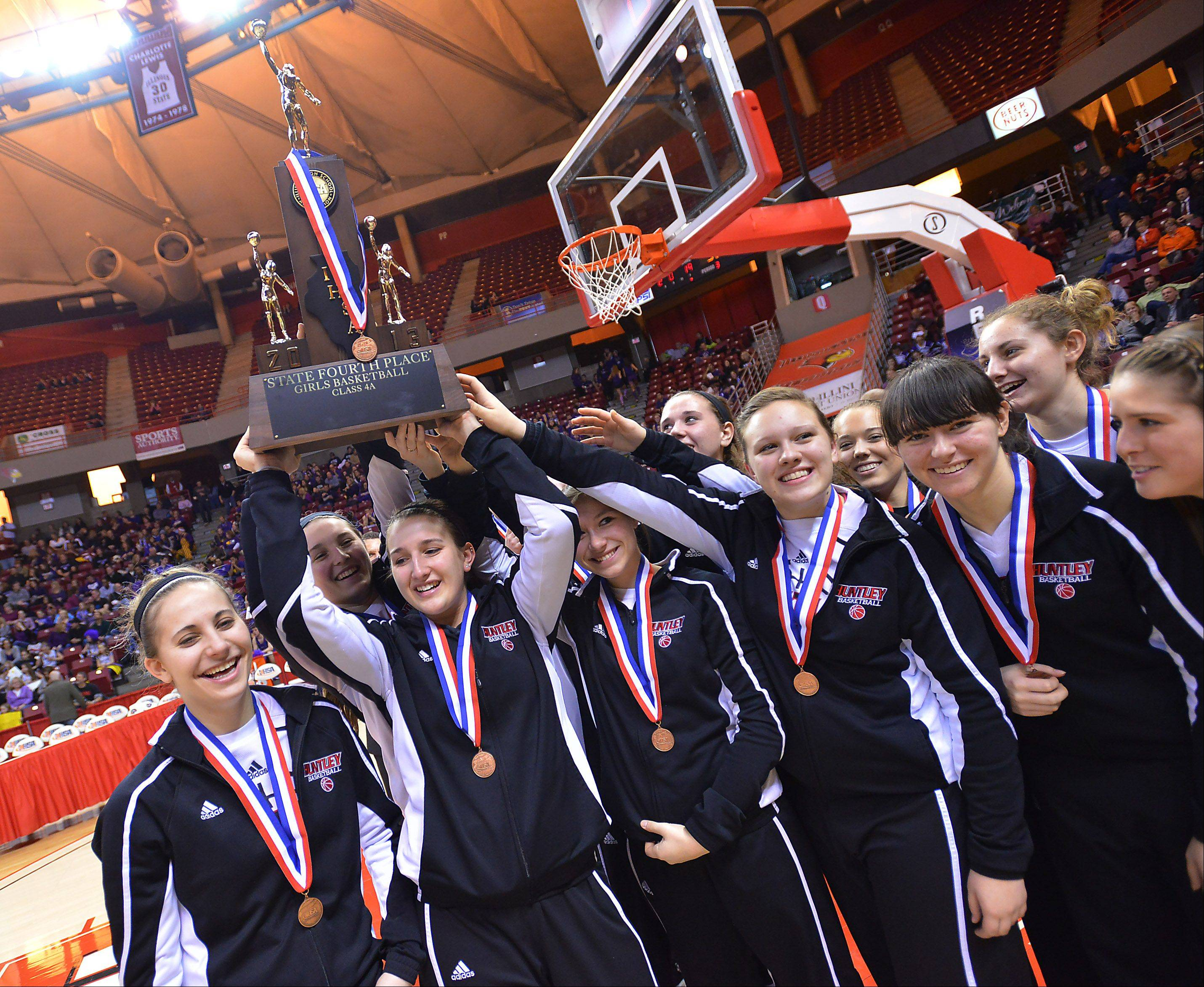 Huntley hoists its fourth-place trophy following Saturday's game against Whitney Young in Normal on Saturday.