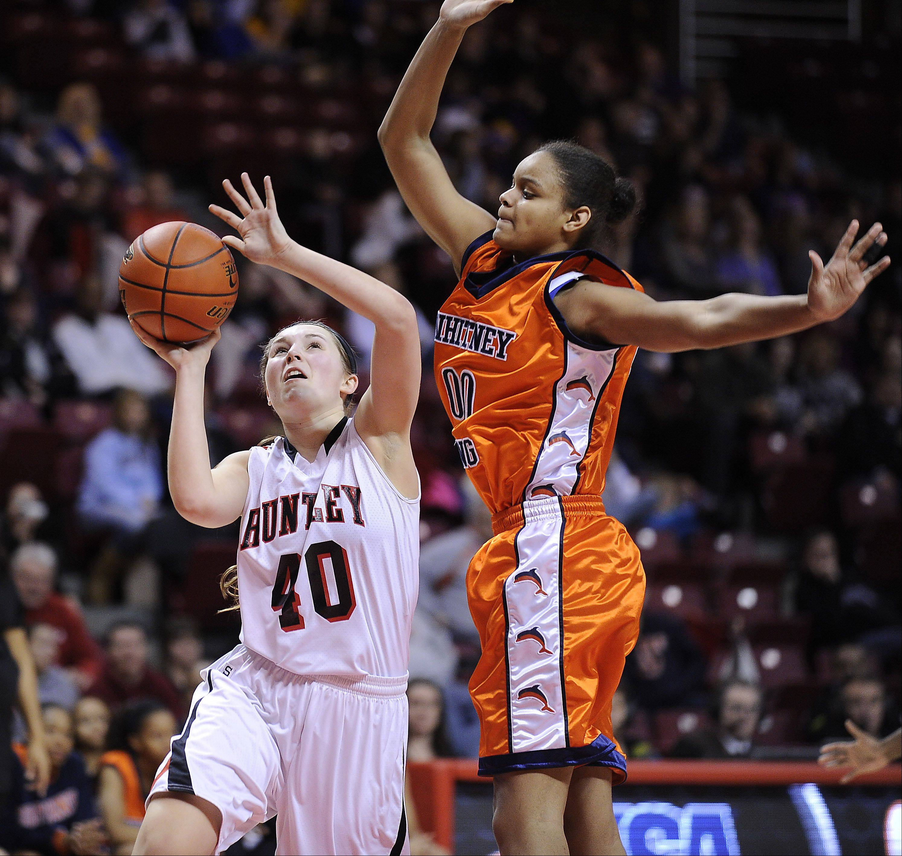 Huntley's Sam Andrews shoots as Whitney Young's Khaalia Hillsman applies pressure in the first half of the Class 4A third-place game Saturday in Normal.