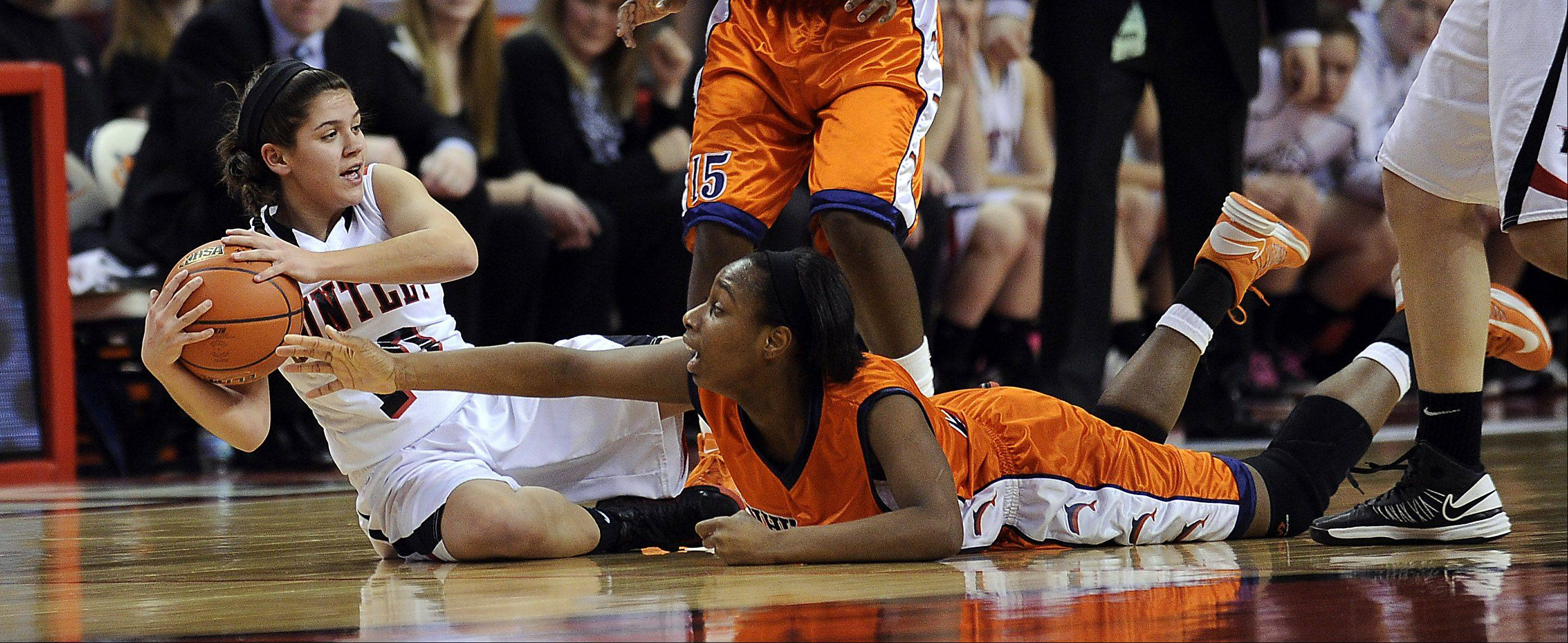 Huntley's Kayla Barreto and Whitney Young's Tanita Allen battle on the floor for a loose ball in the Class 4A third-place game in Normal on Saturday.