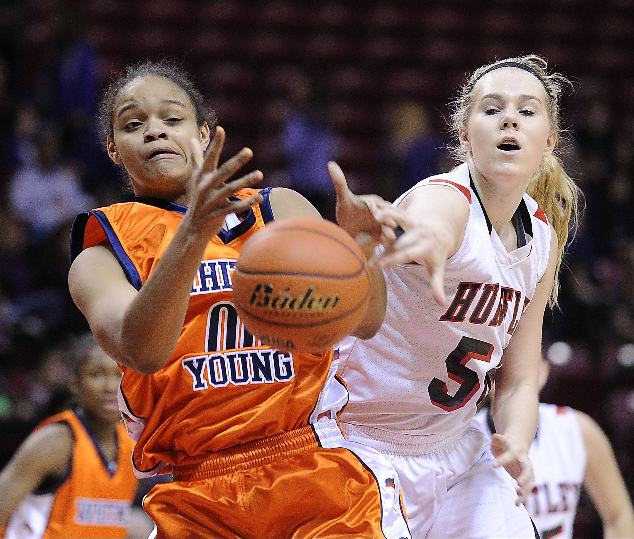Huntley's Ali Andrews knocks the ball away from Whitney Young's Khaalia Hillsman in the first half of the Class 4A third-place game Saturday in Normal.
