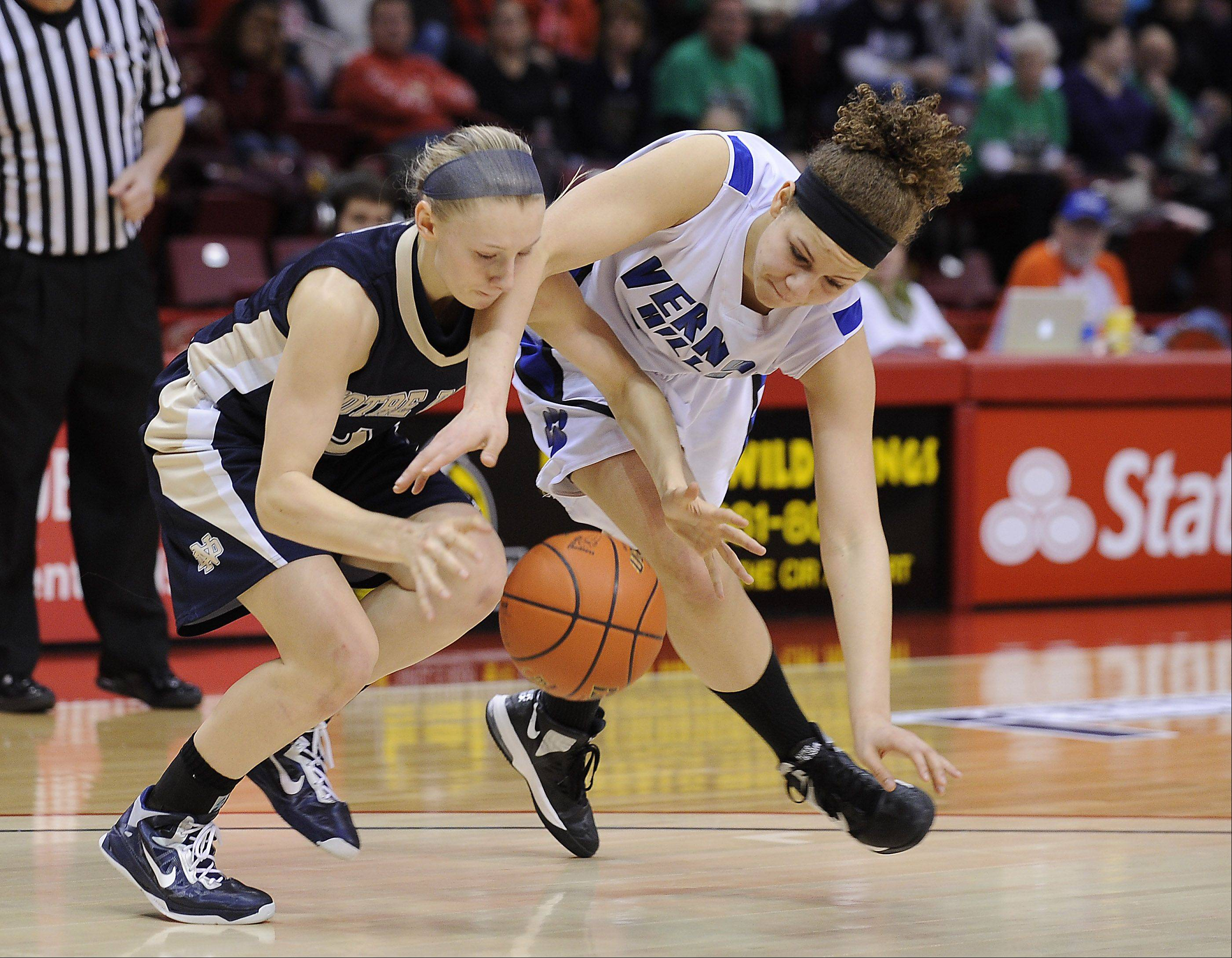 Vernon Hills Brie Bahlmann and Quincy Notre Dame Notre Dame's Kristen Gengenbacher battle for a loose ball in the fourth quarter at the Class 3A state girls basketball championship game in Normal on Saturday.
