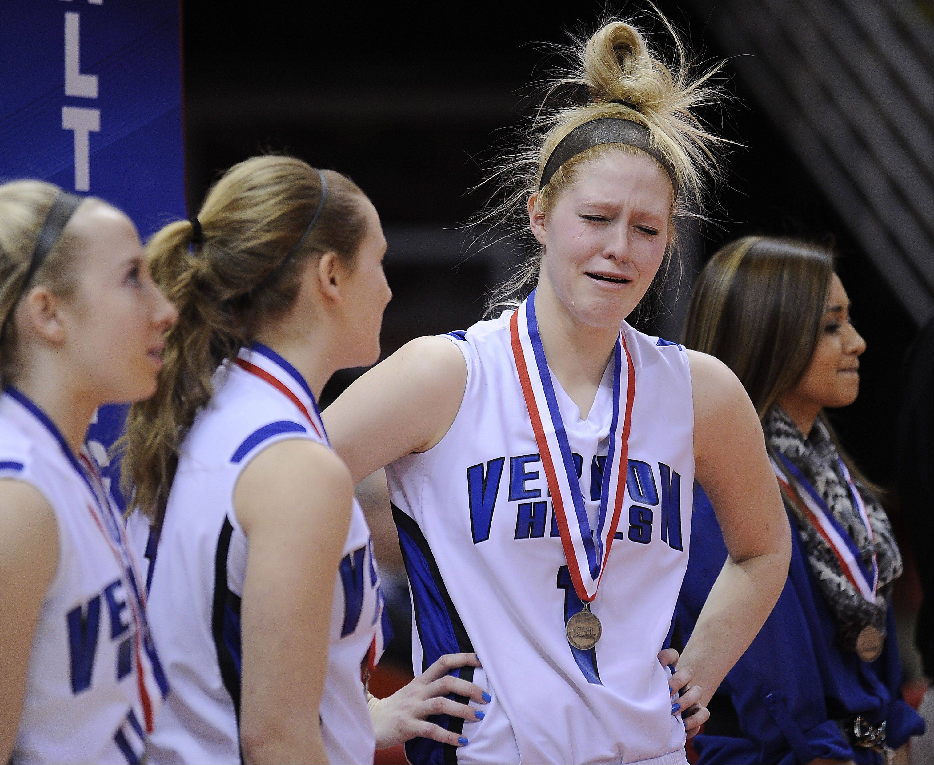 Vernon Hills' Sydney Smith becomes emotional after they lost to Quincy Notre Dame Notre Dame in the Class 3A state girls basketball championship game in Normal on Saturday.
