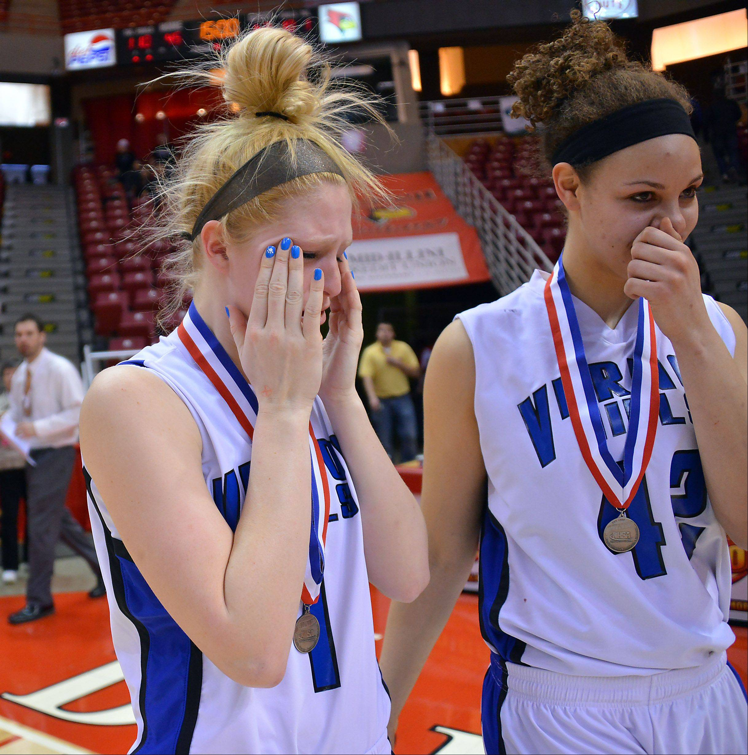 Vernon Hills' Sydney Smith becomes emotional with teamate Lauren Webb after they lost to Quincy Notre Dame Notre Dame in the Class 3A state girls basketball in Normal on Saturday.